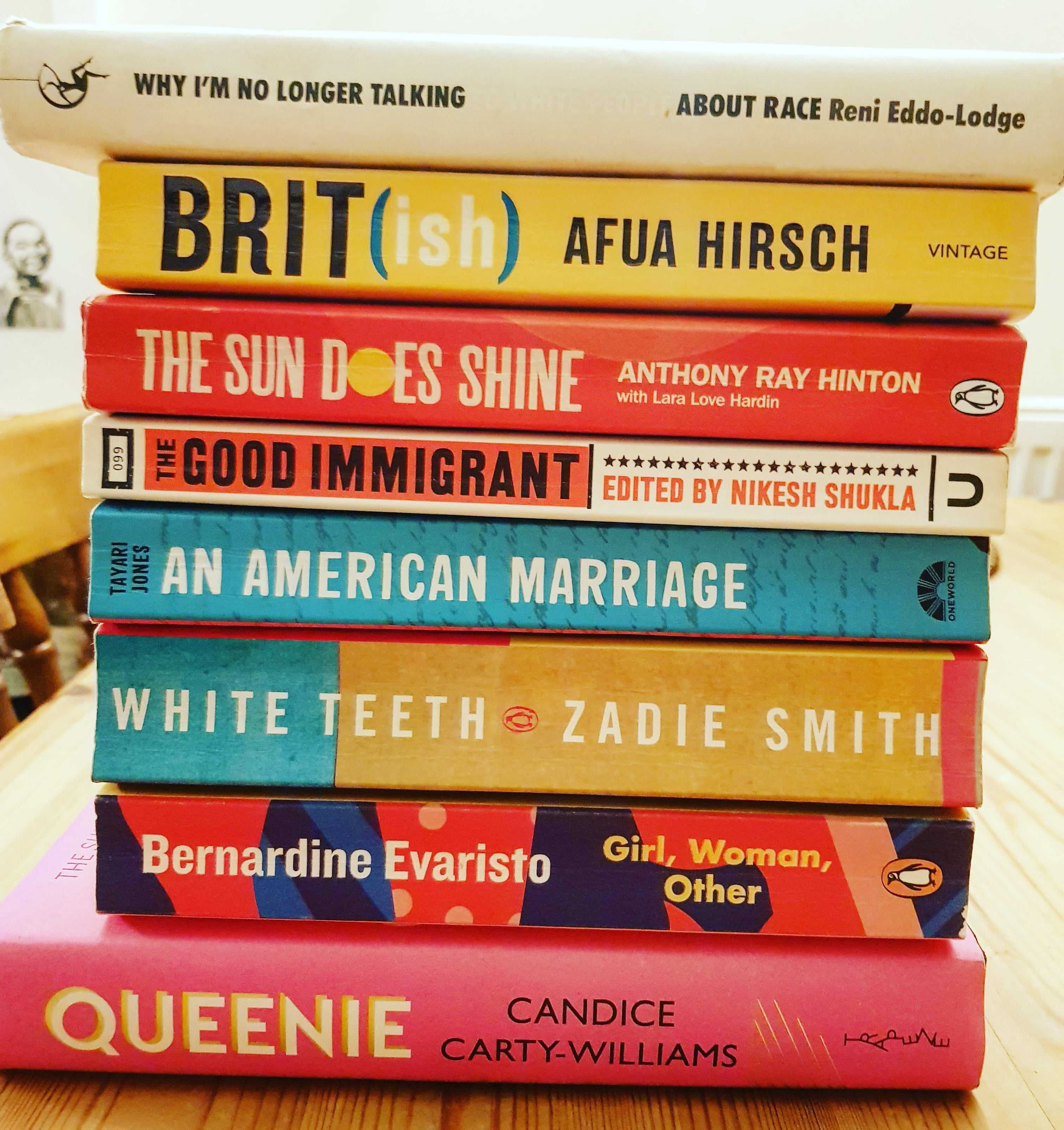 A stack of books about race, identity and belonging. The stack includes titles by Zadie Smith, Afua Hirsch & Reni Eddo-Lodge.