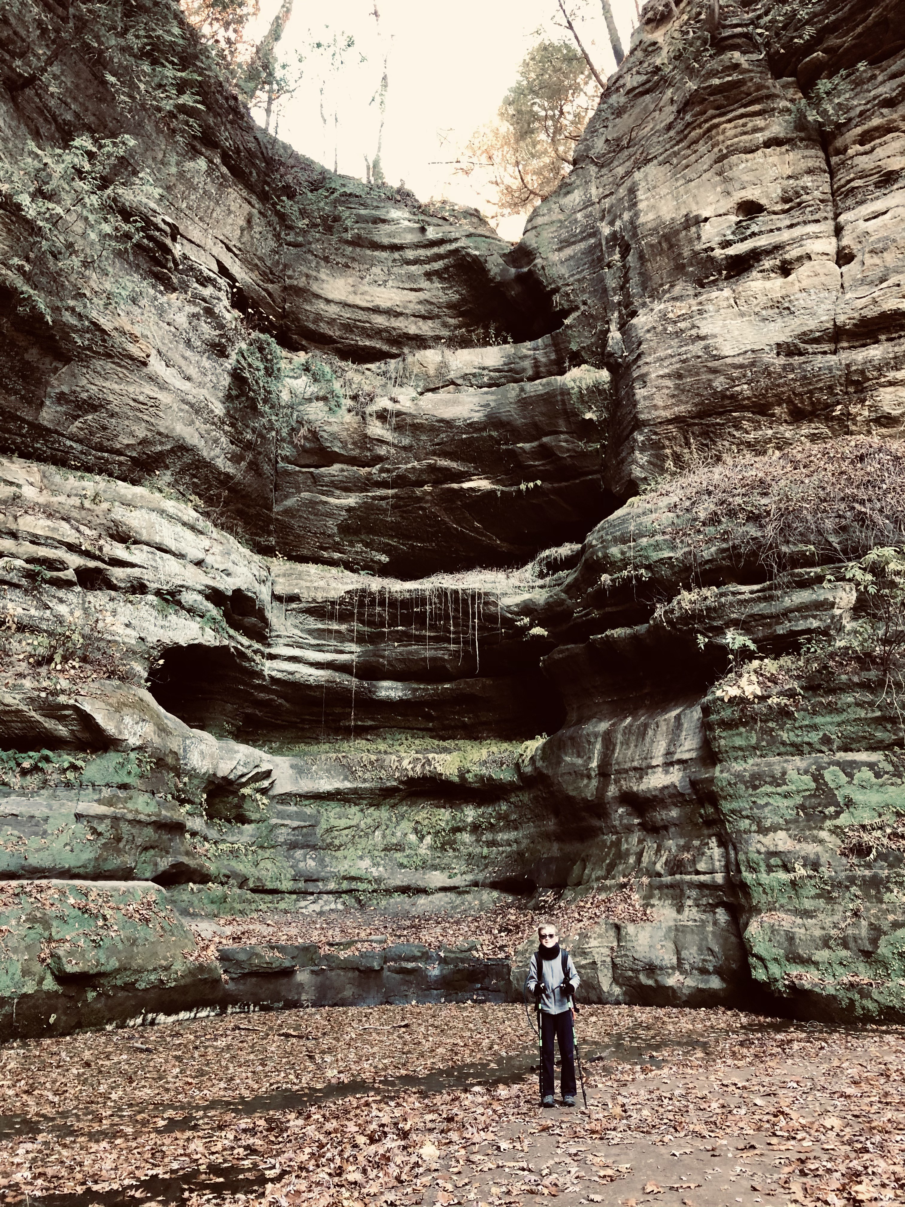 Photo of a young man standing in a canyon in Starved Rock State Park in Oglesby, Illinois.