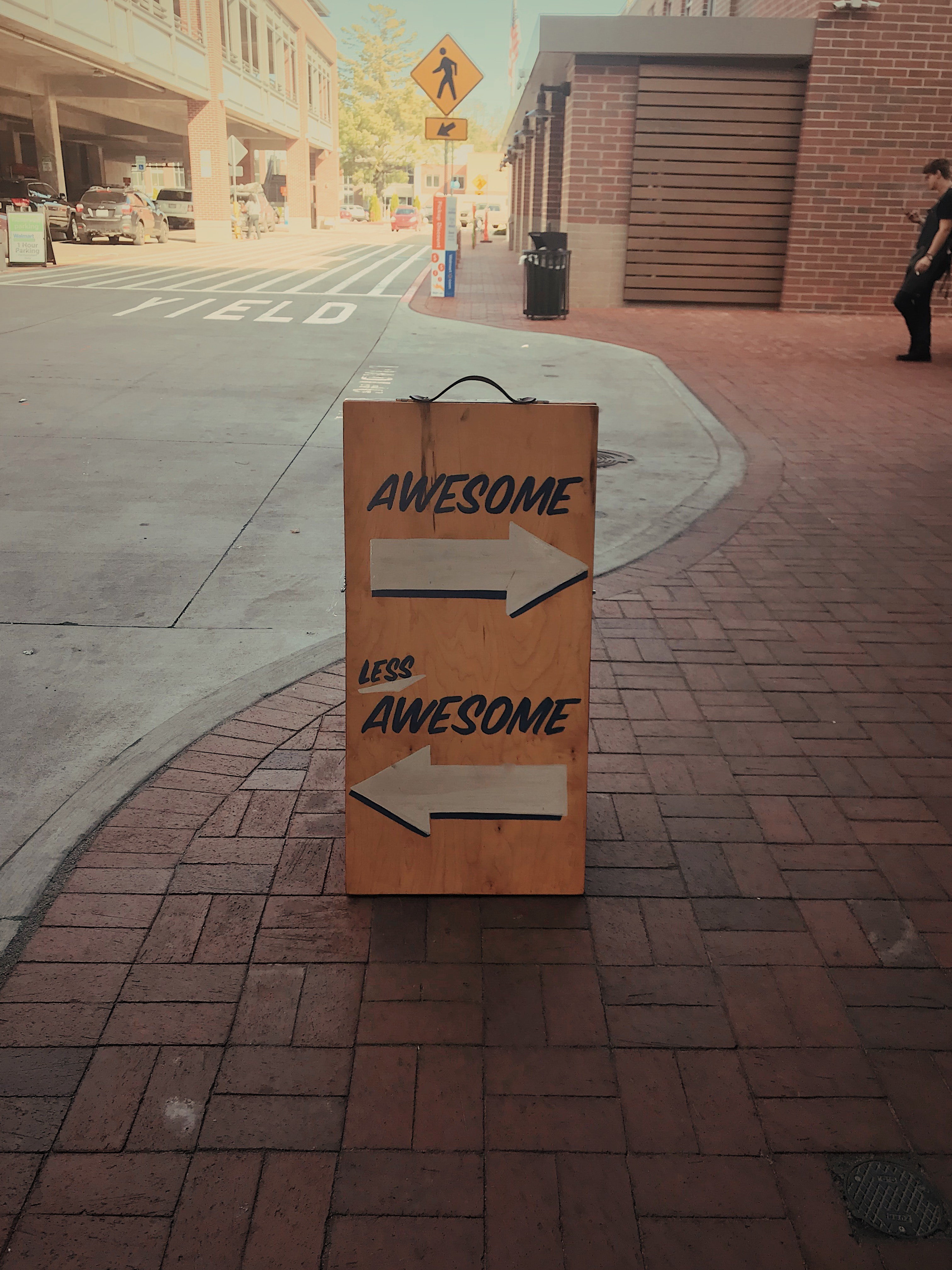 A sign with awesome pointing to the right, and less awesome pointing left.
