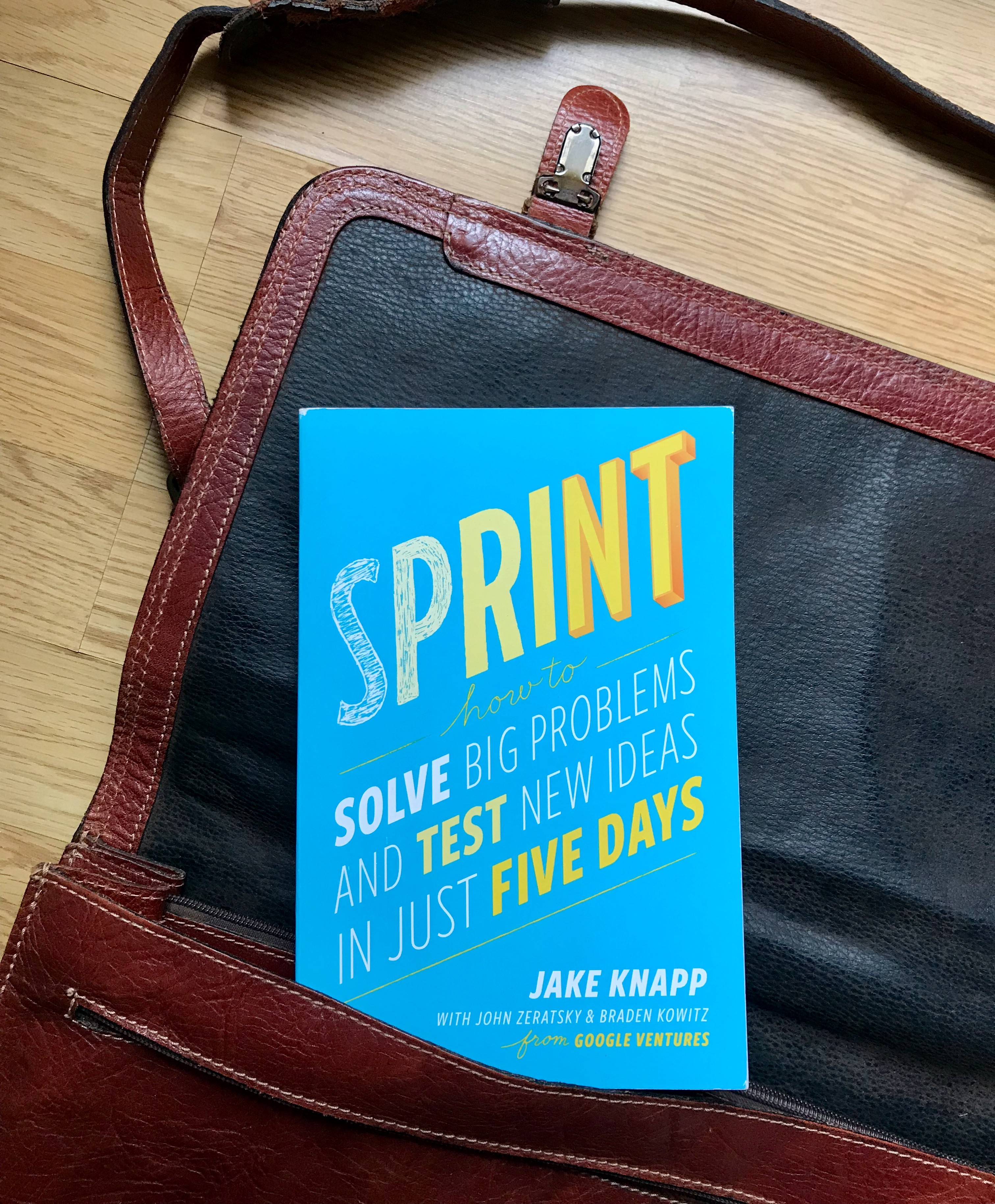 'Sprint' book by Jake Knapp coming out a leather shoulder bag