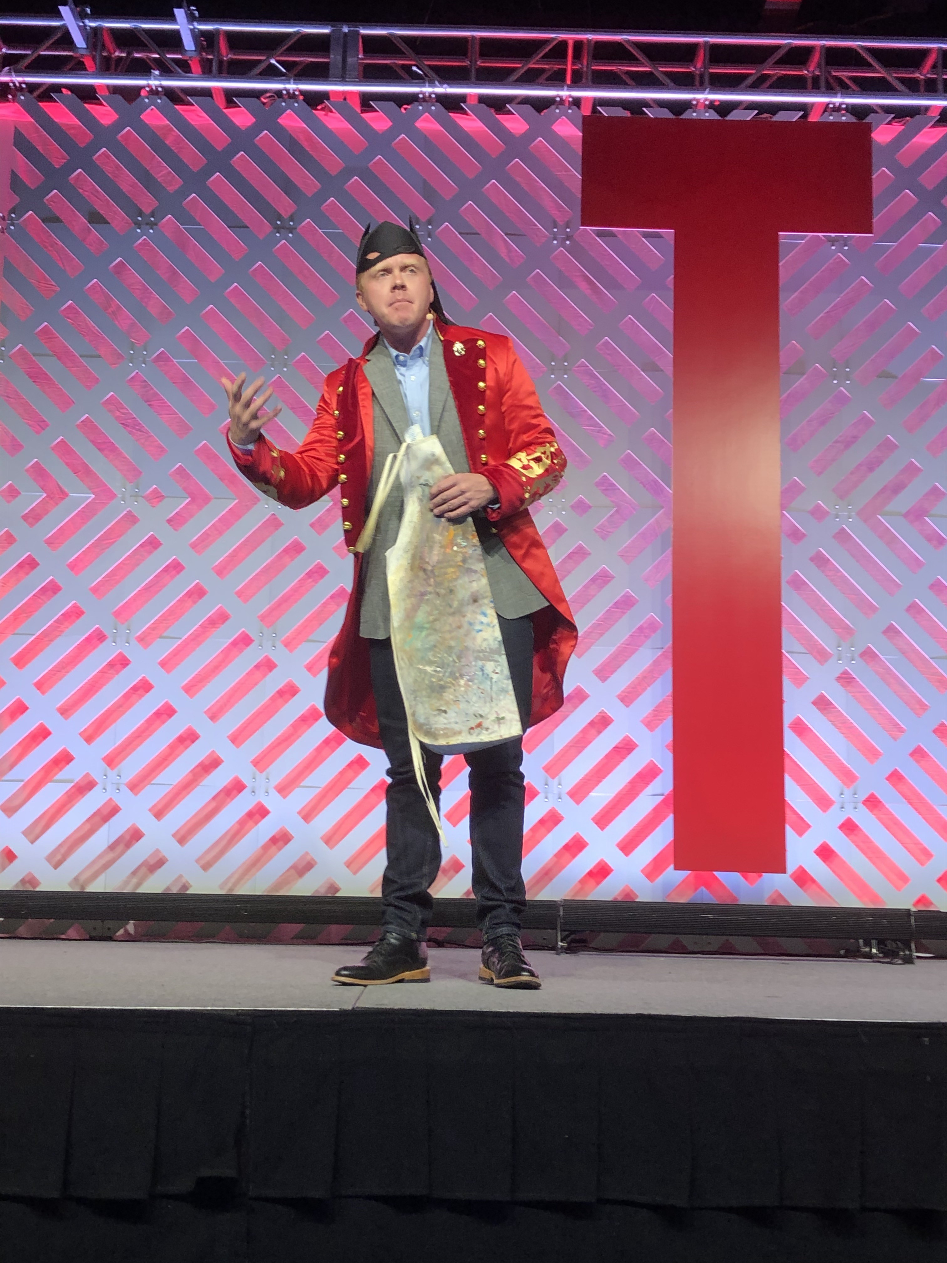 Jeff Goins on Tribe Conference stage wearing costumes from past conferences.