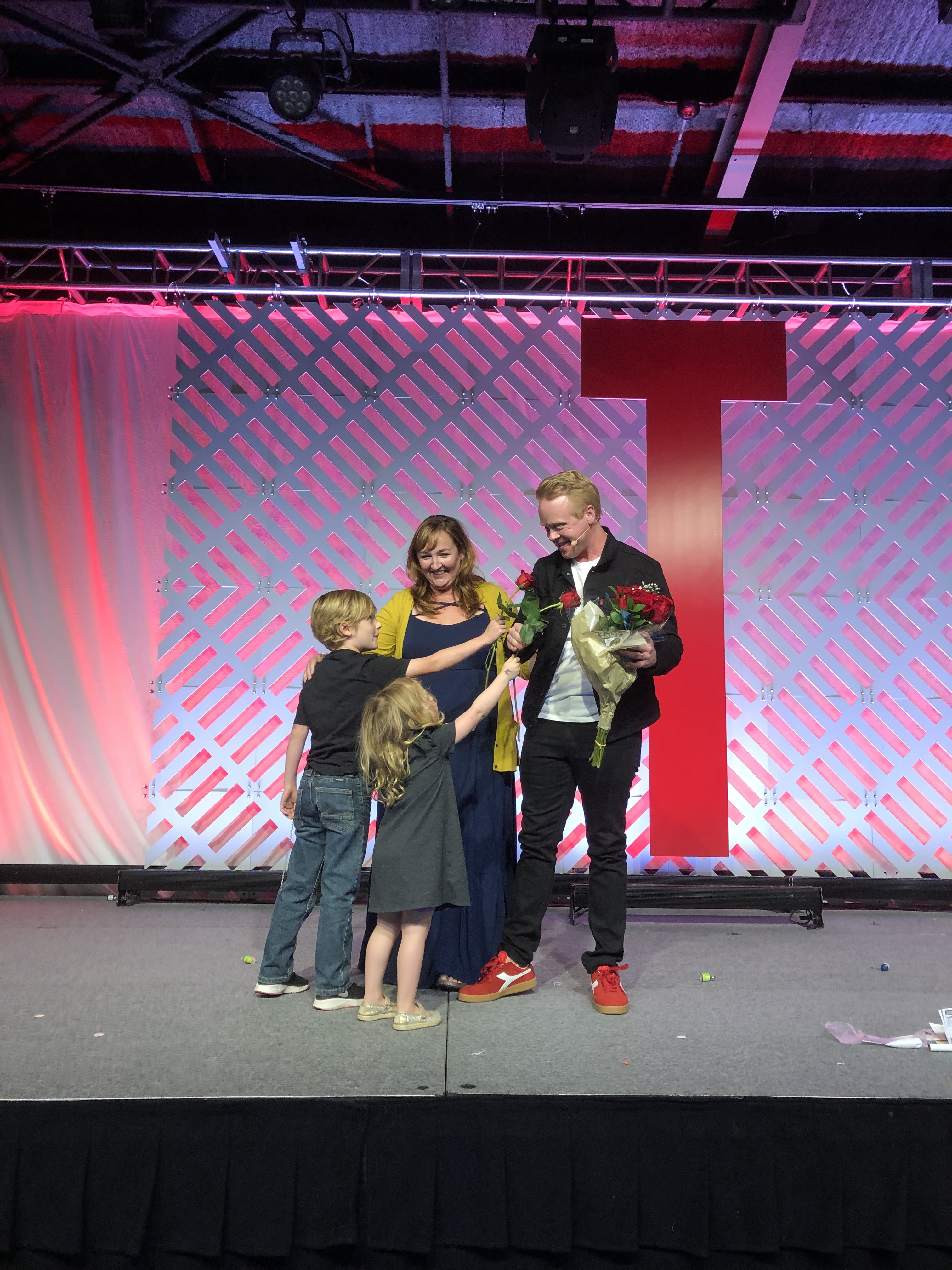 Jeff Goins on stage with wife, son and daughter at the closing of Tribe Conference.