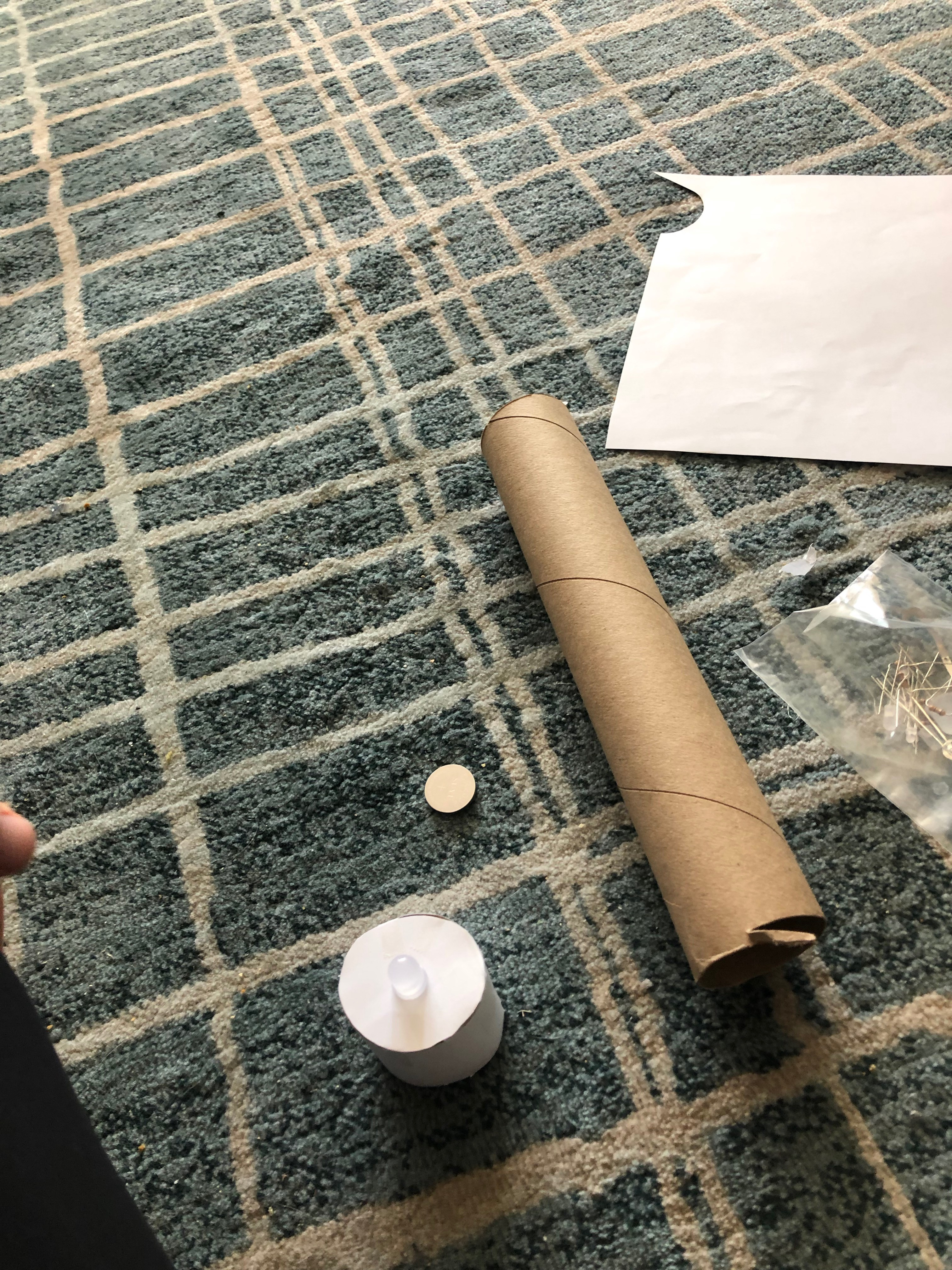 A picture of the paper, paper towel roll and LEDs I used to make a paper tea light enclosure.