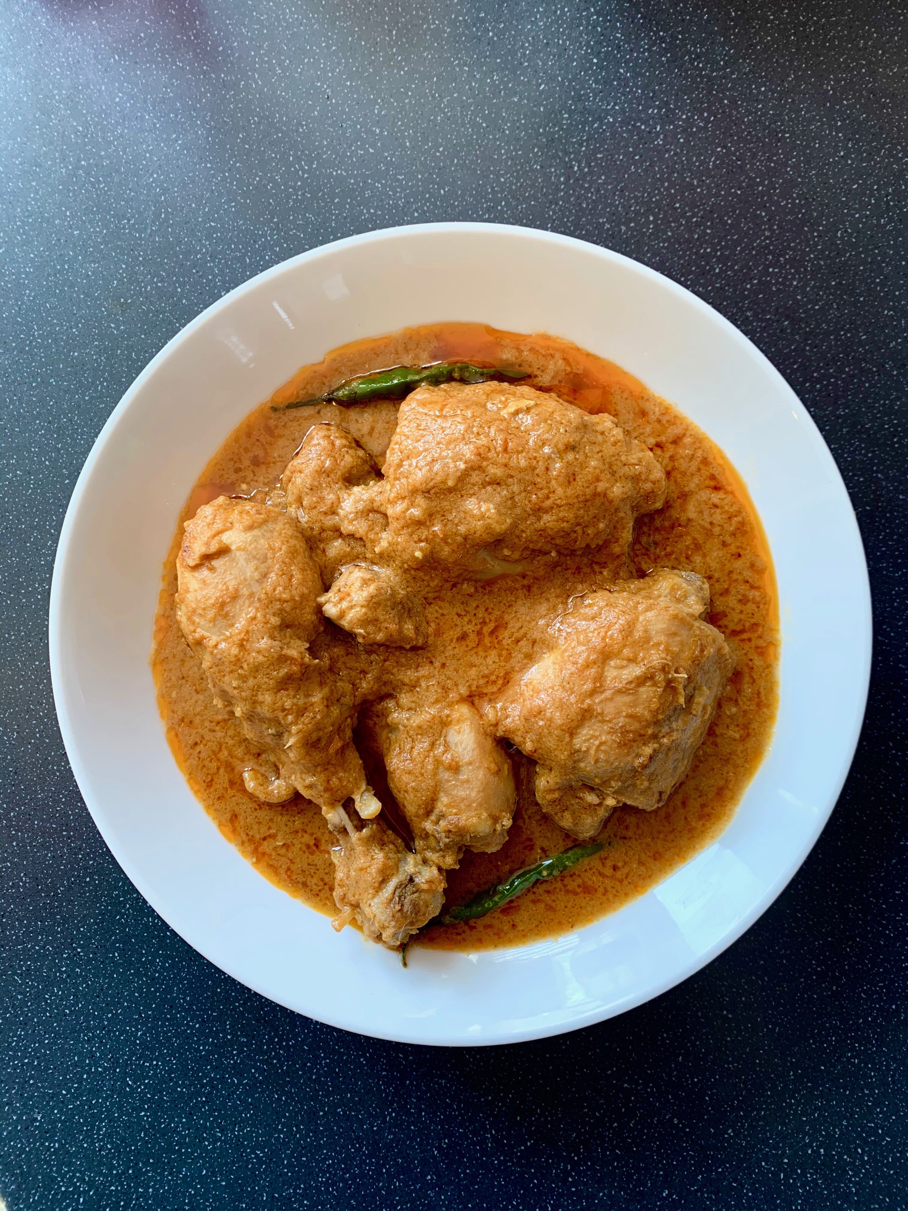 A bowl of chicken curry.