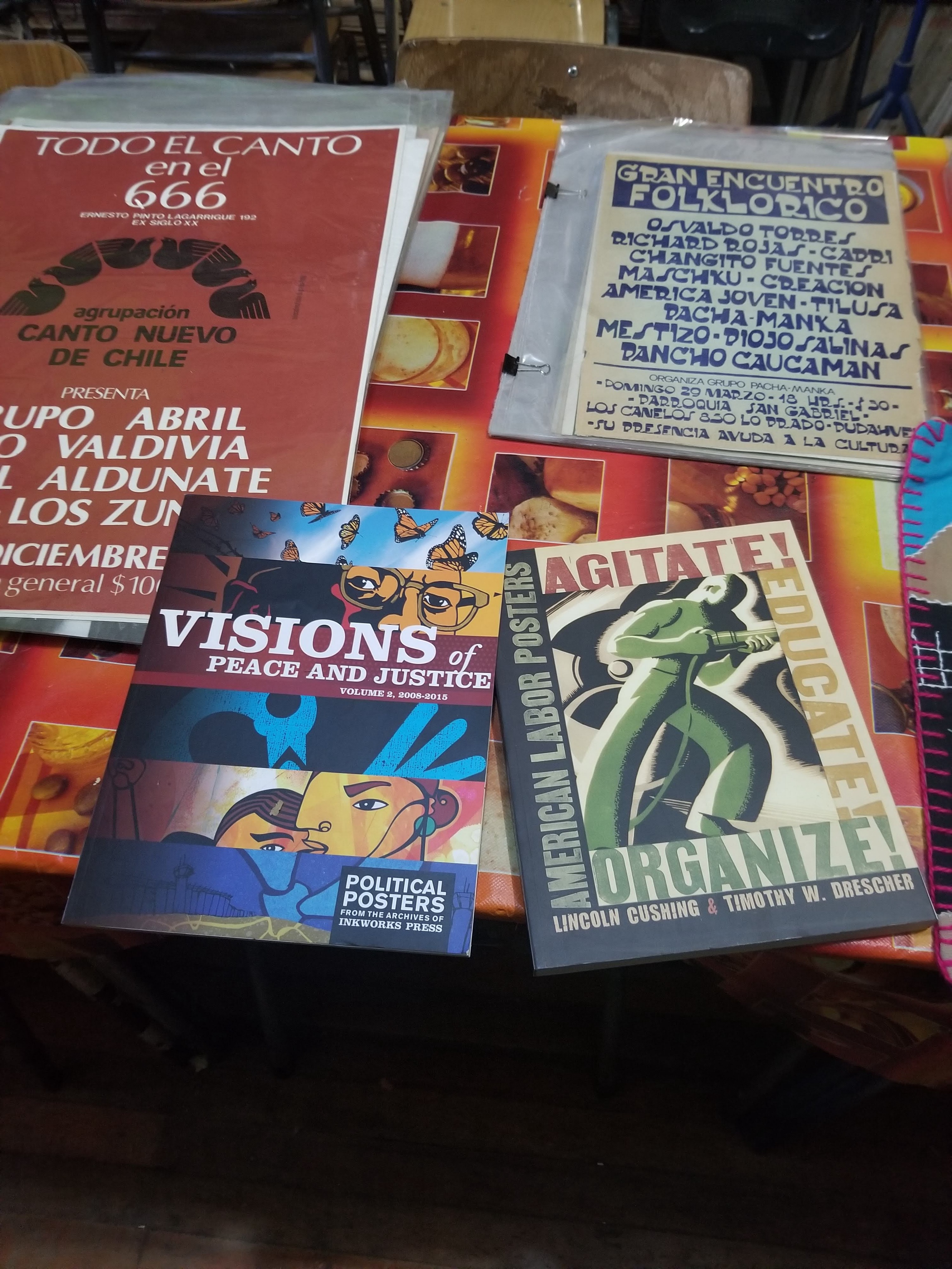 Photo of books, posters, and flyers from the Archive of the Graphic Resistance in Santiago, Chile