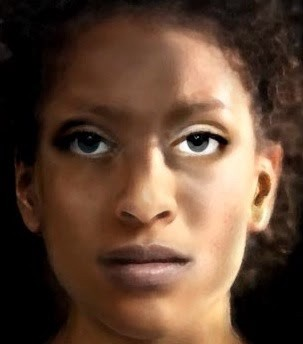 A close-up of a beautiful Black woman's face, partially in shadow.