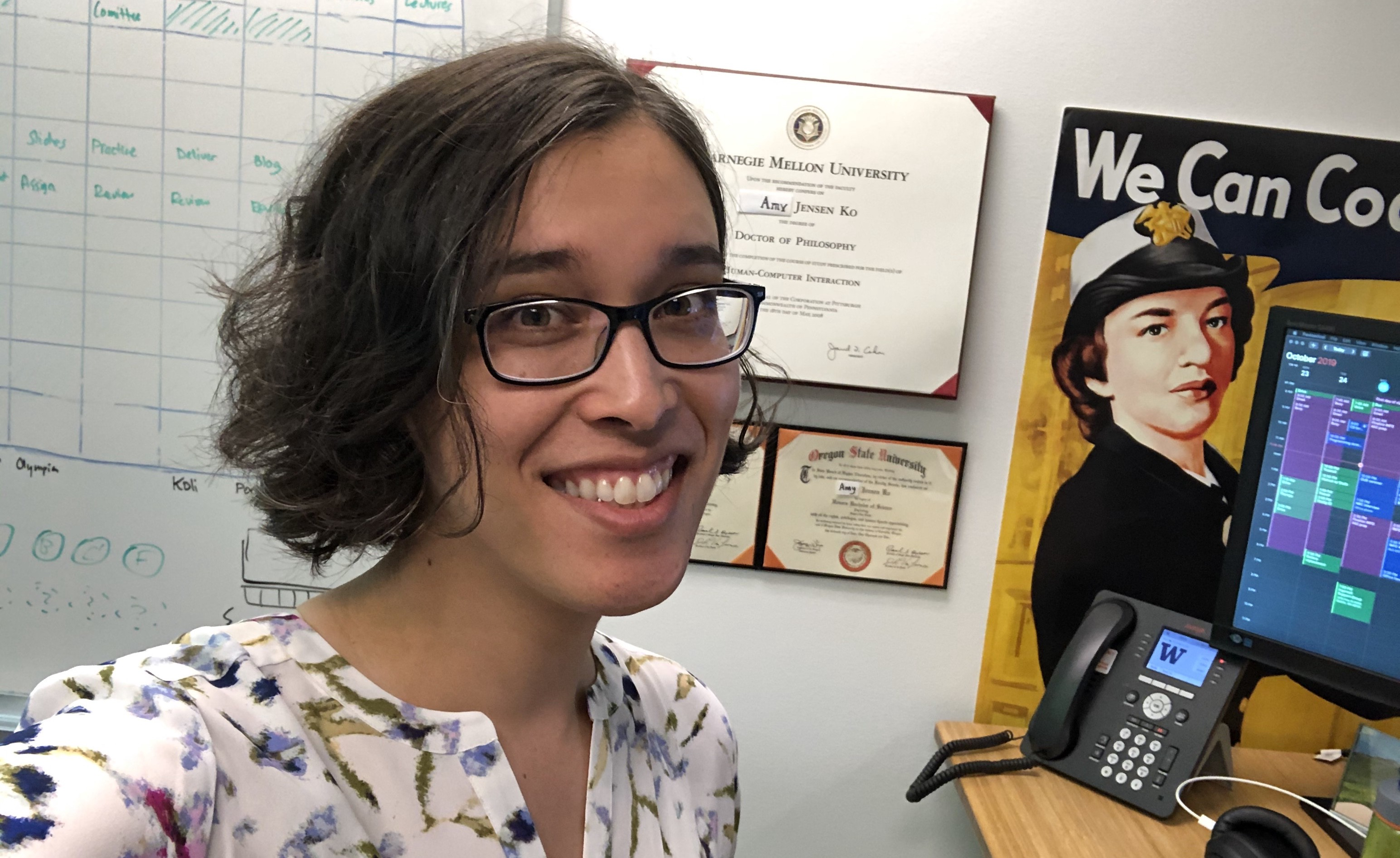 Amy smiling in front of her desk.