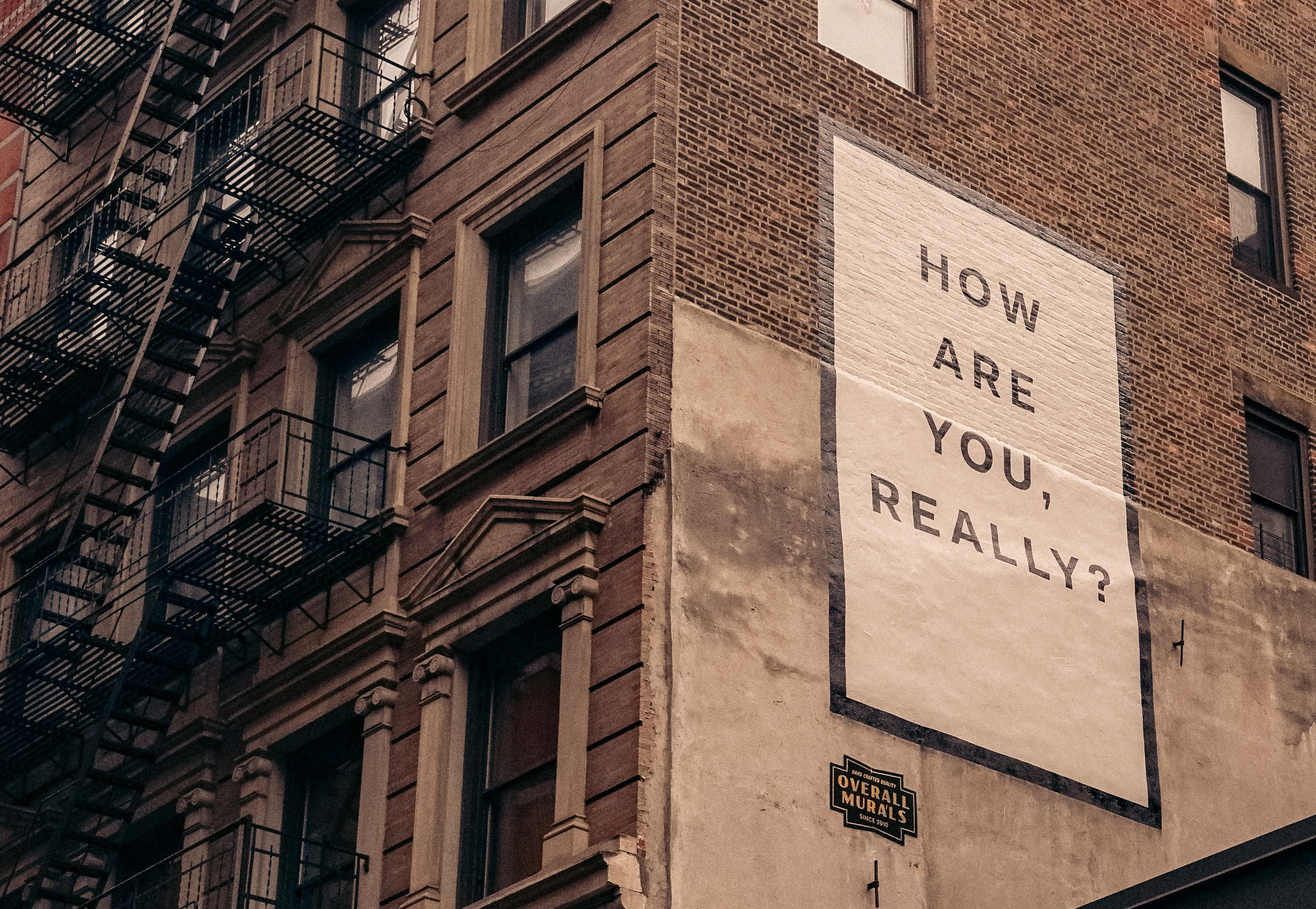 billboard with text saying how are you, really?