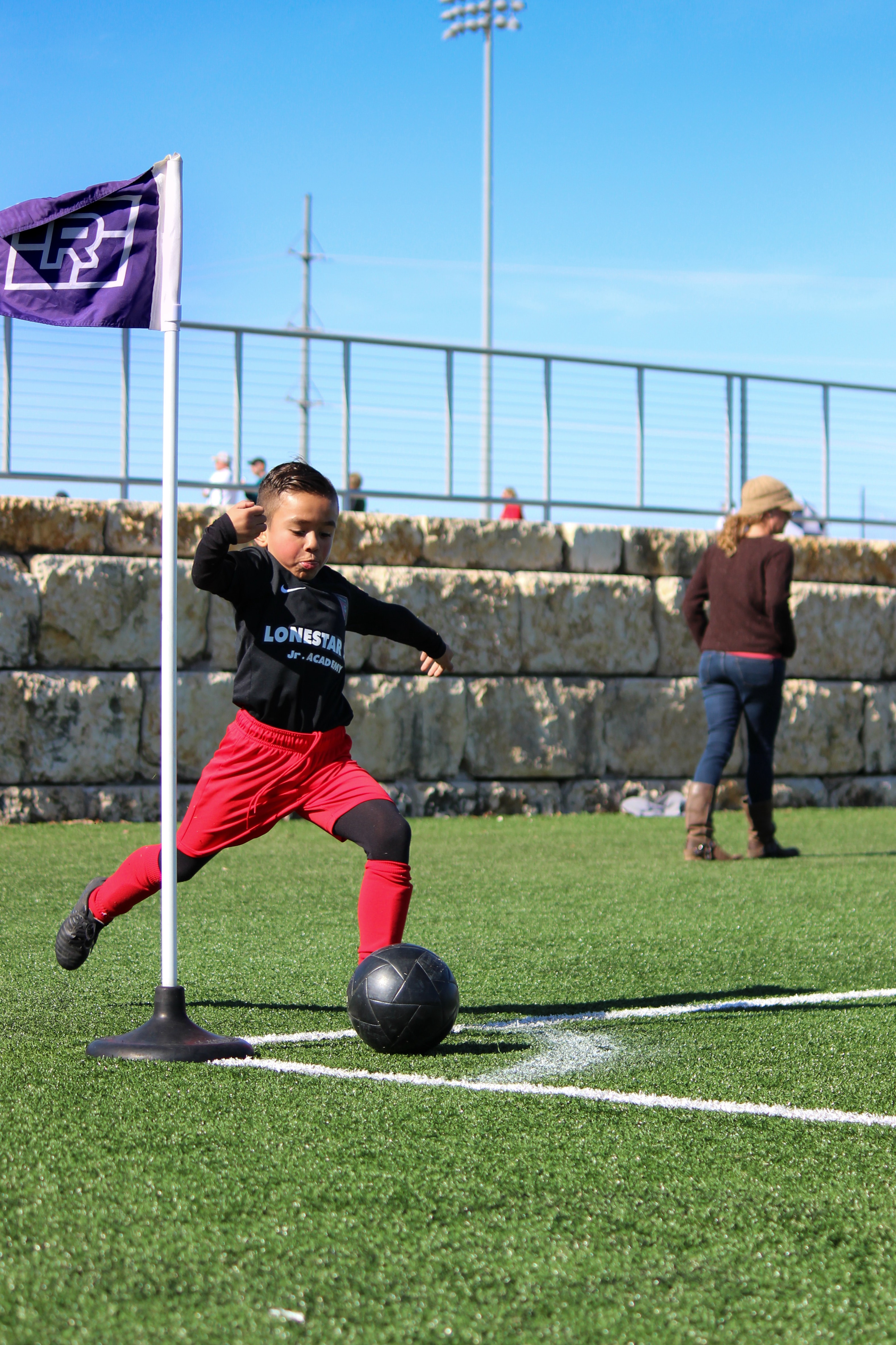 Young boy plays soccer.