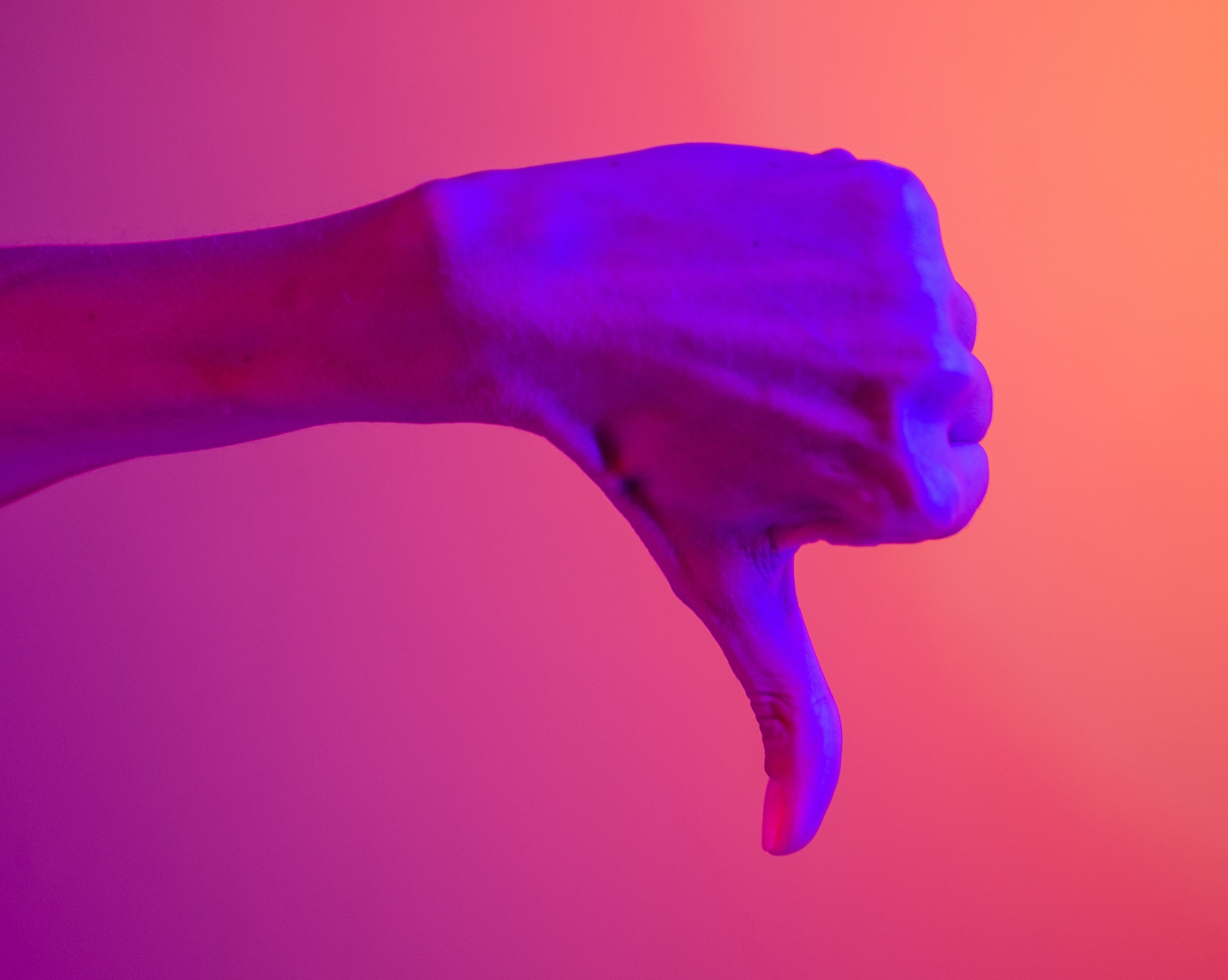 Close-up of a thumbs down for therapists who suck