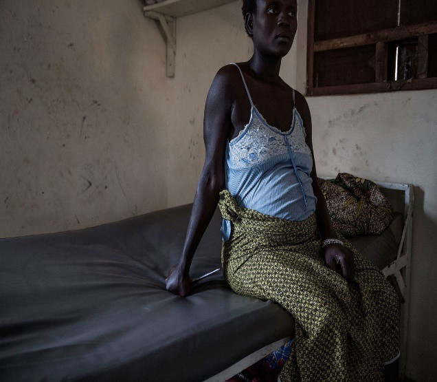 Woman sitting on bed. Image credit: Safe Motherhood Alliance