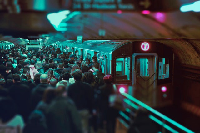 A crowded and dark train station—Photo by Victor Rodriguez on Unsplash