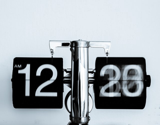 A digital clock where time is blurry as an indication to time passing - Photo by Djim Loic on Unsplash