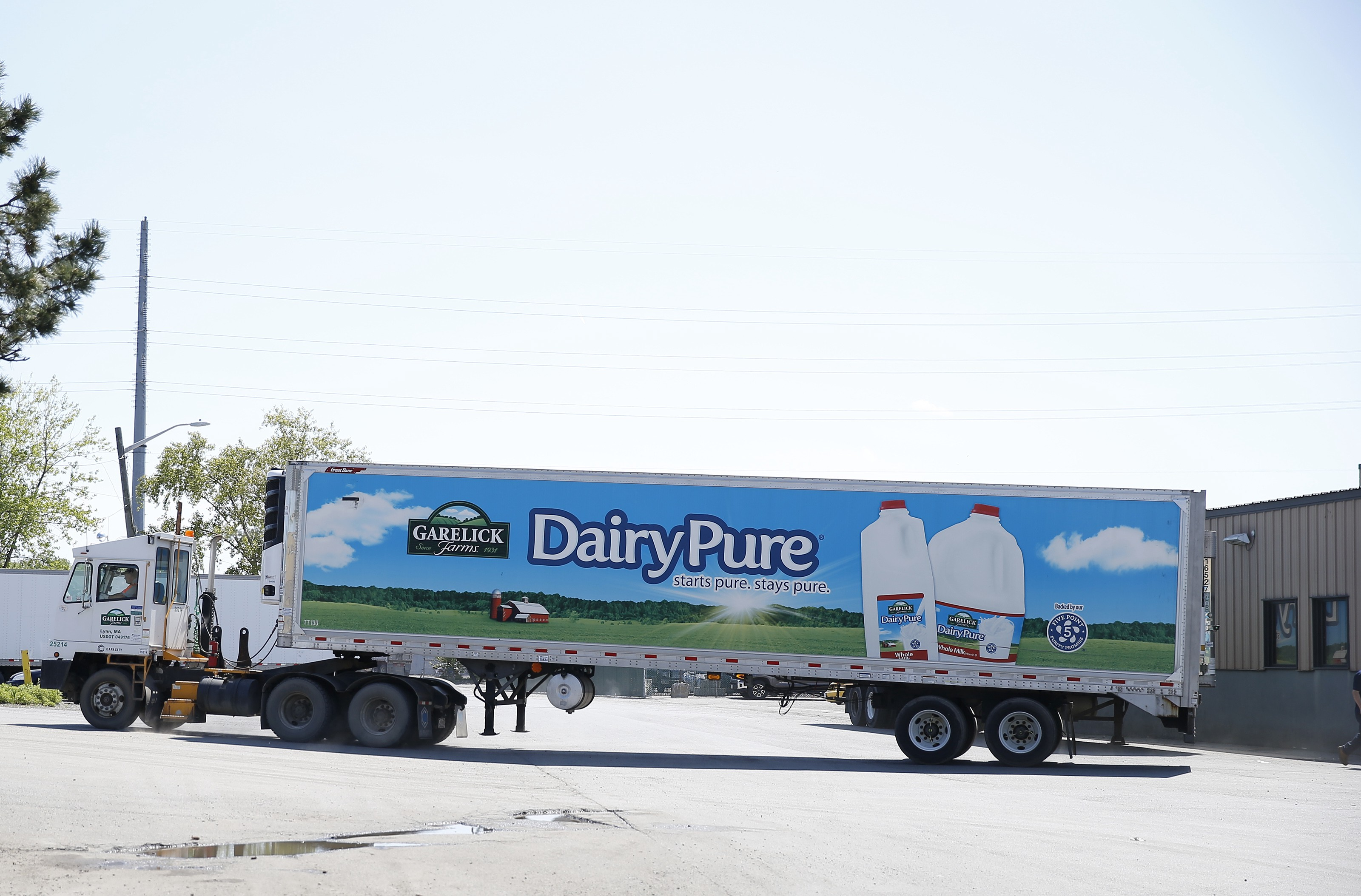 A milk truck pulls away from the Garelick Farms manufacturing plant in Lynn, MA. The plant closed in fall of 2018.