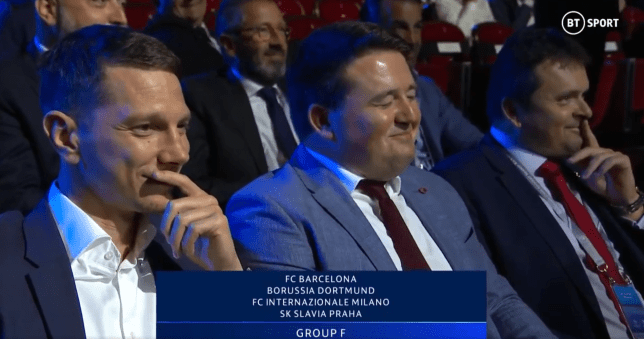 Slavia Prague delegates look on and laugh at their unfortunate group draw against Barcelona, Dortmund and Inter.
