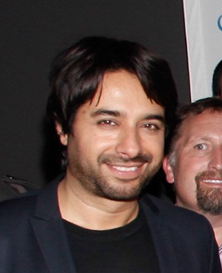 Jian Ghomeshi, with brown hair and a scruffy beard and mustache