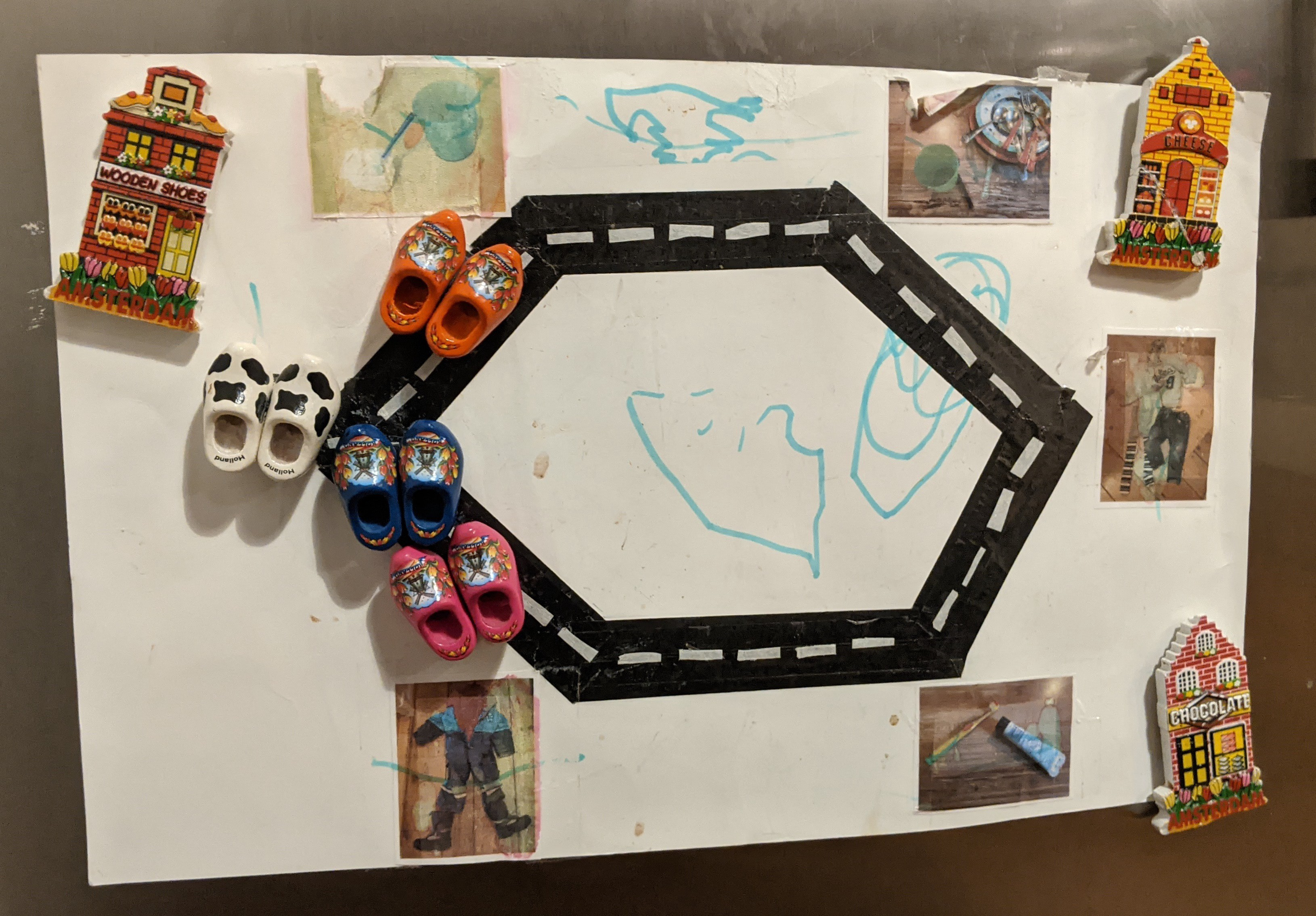 The morning race track, with stains and felt-pen scribbles, attached to a refrigerator with magnets.