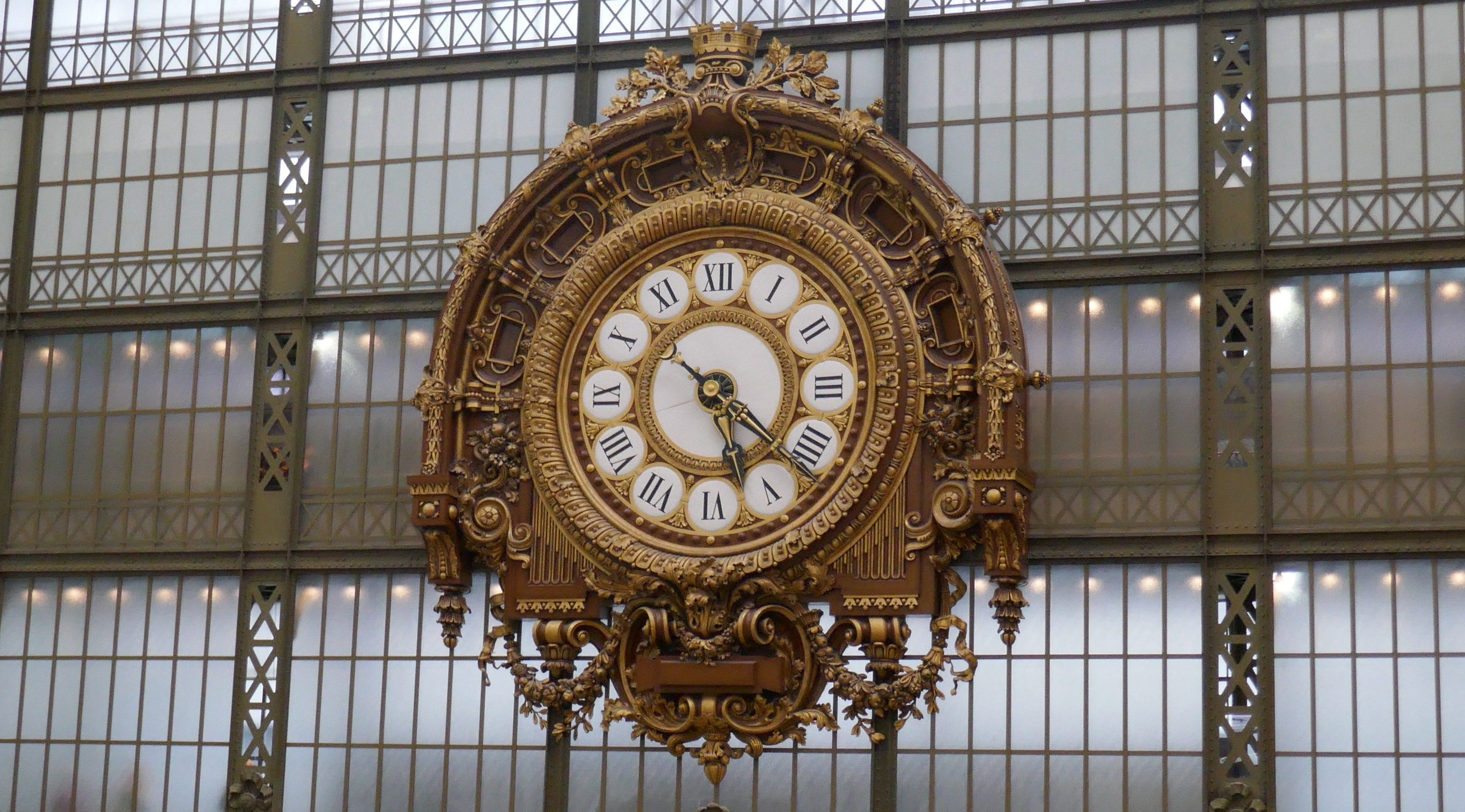 the large gold-colored clock in the Musee d'Orsay-defining moments