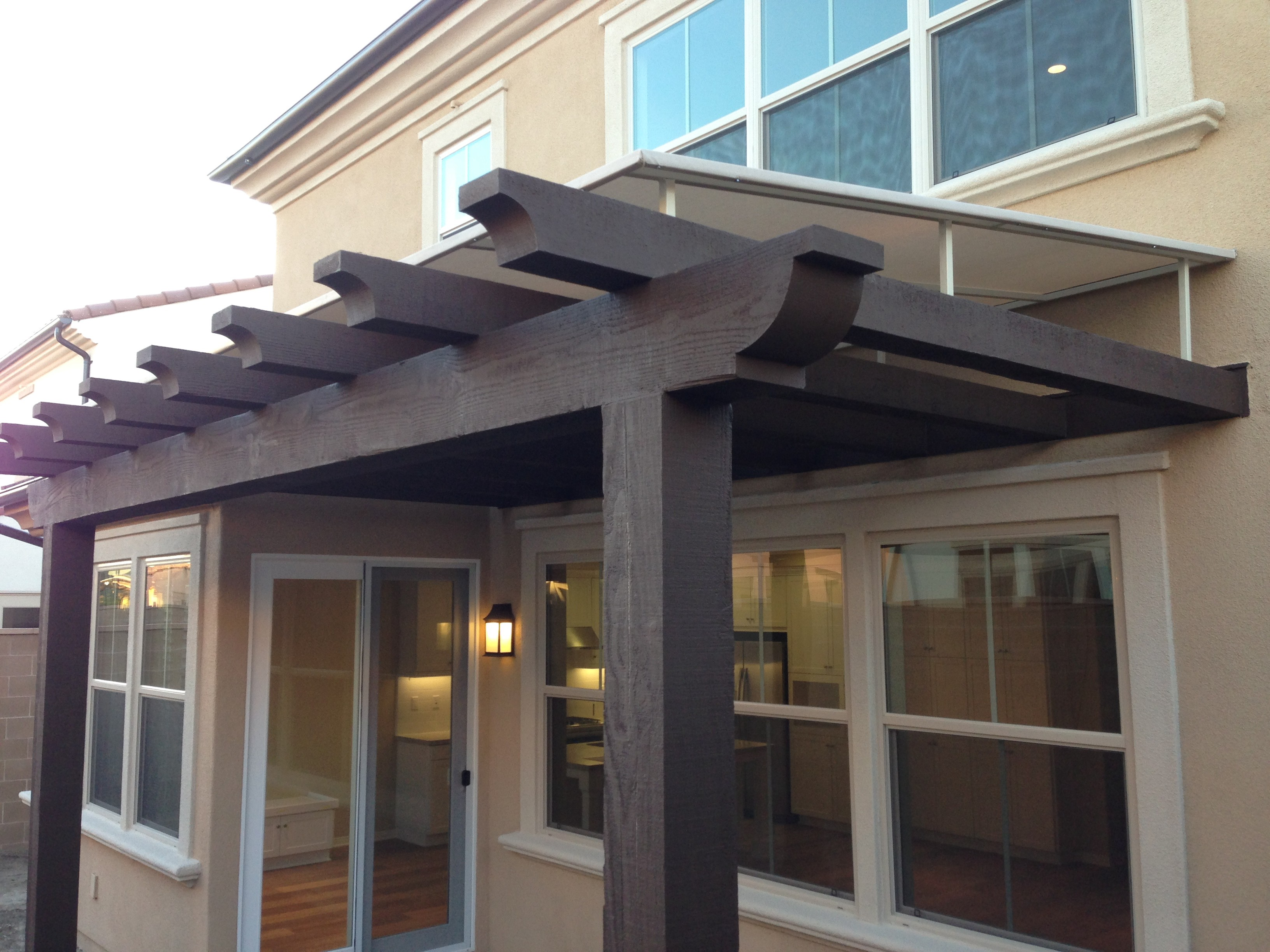 Having a wooden awning can provide extra space to your ...