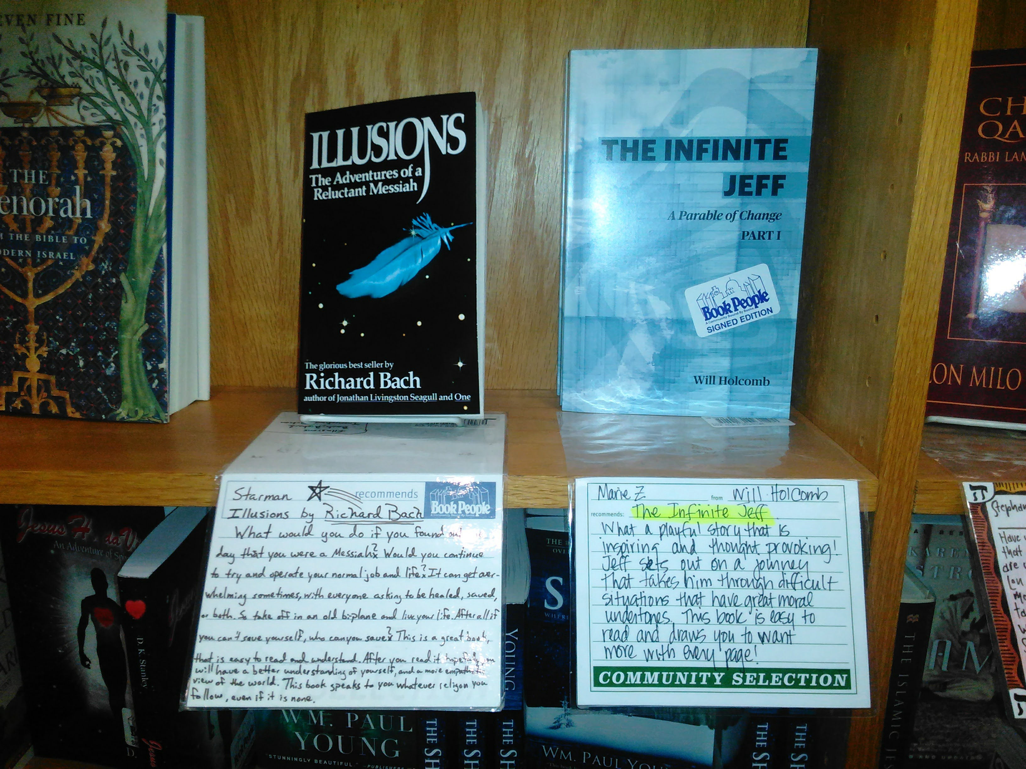 The Infinite Jeff, by author Will Holcomb on the shelf at Book People in Austin, Texas next to Richard Bach's Illusions.