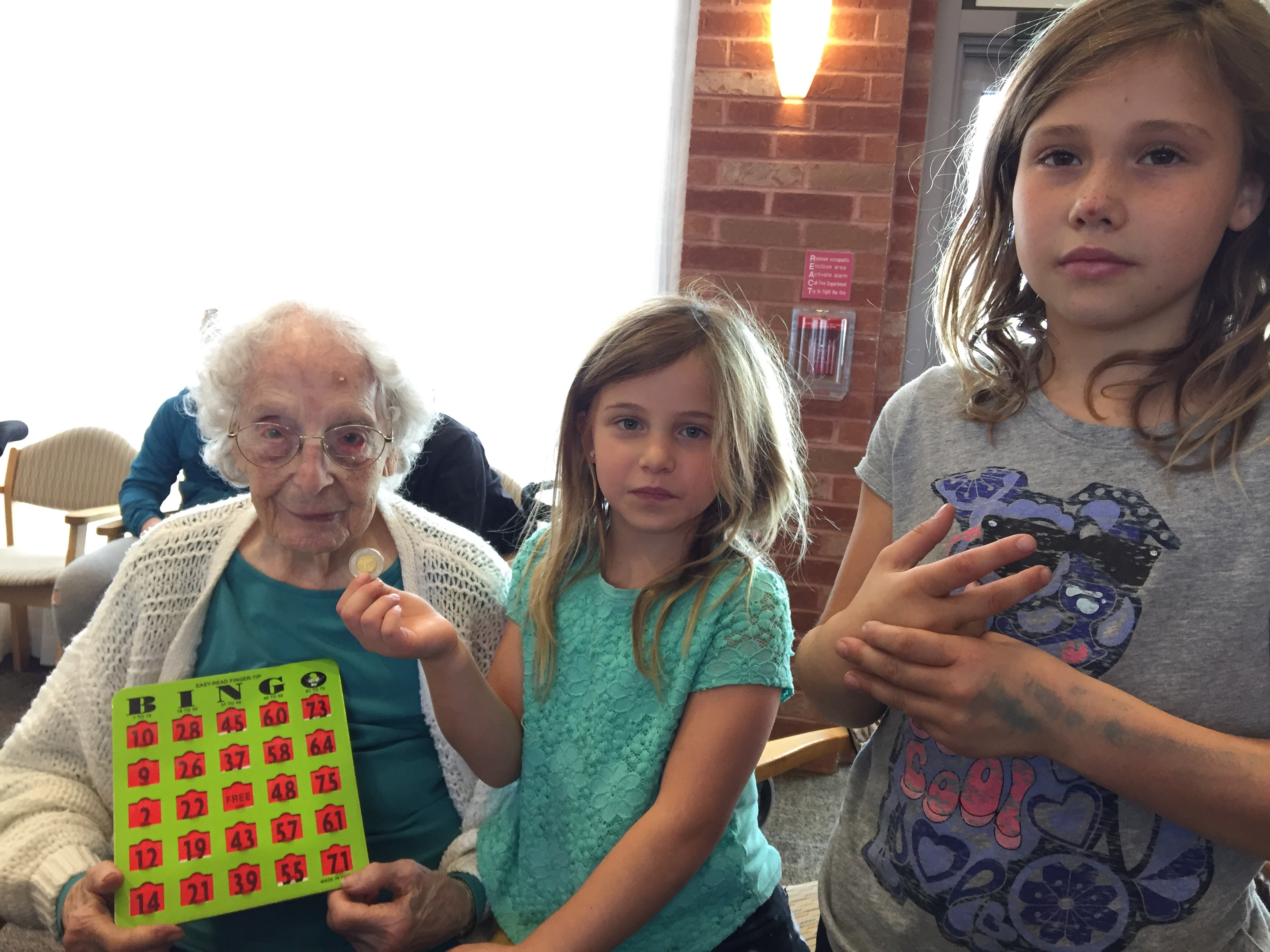 Madge always won at Bingo. Photo with Madge at 108 years old and two of her great granddaughters