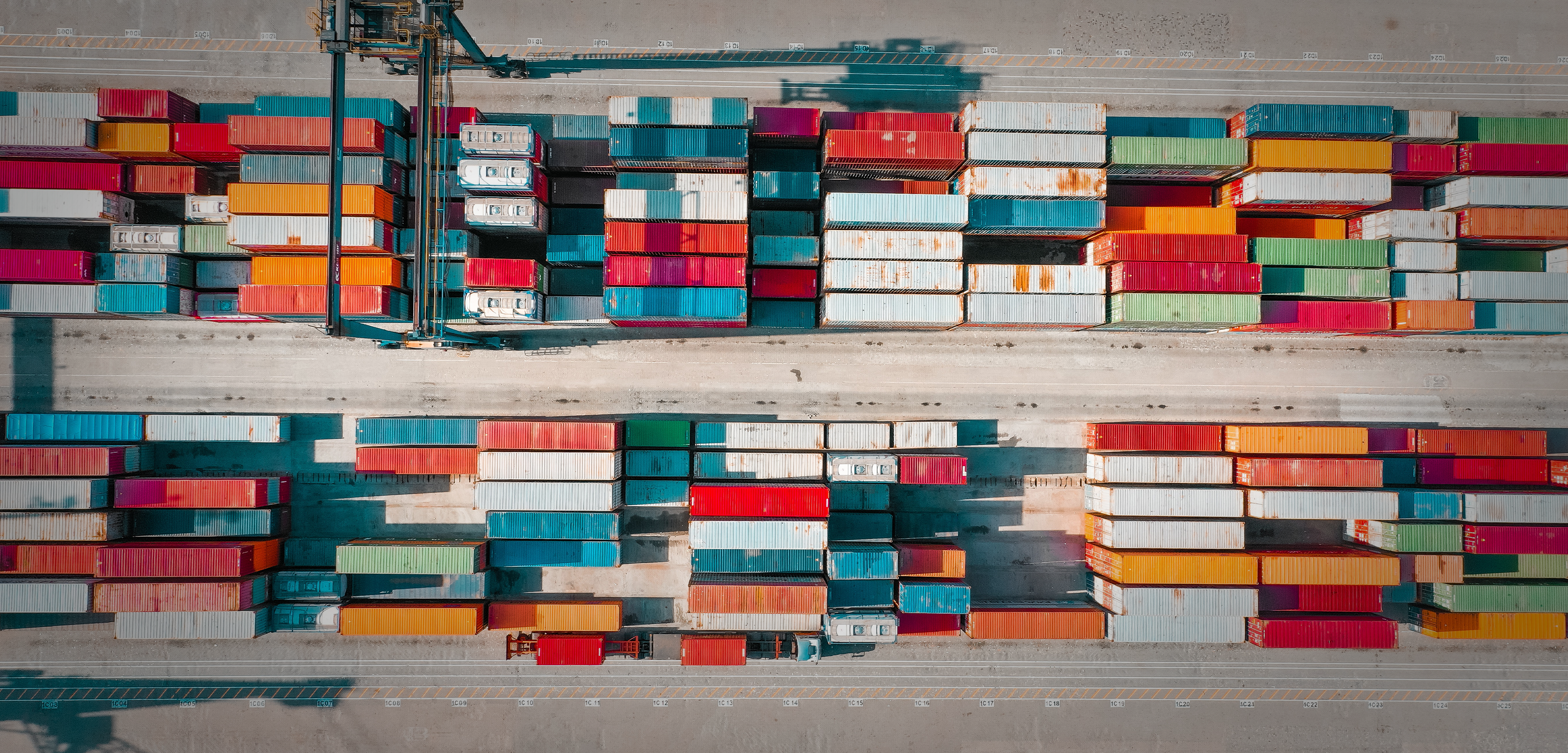A bird's-eye view of coloured shipping containers.