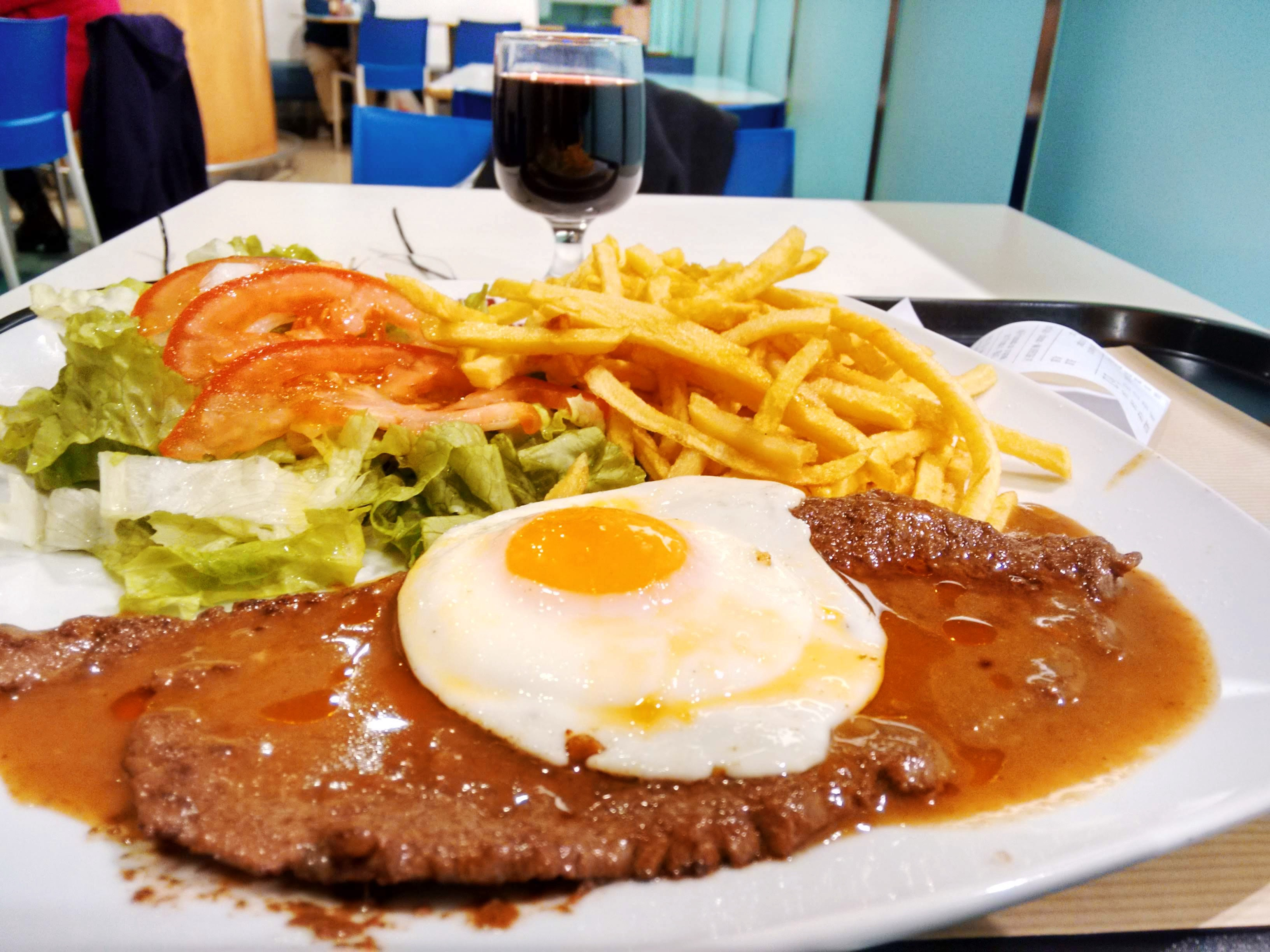 "A ""bitoque"" — pork steak with a fried egg on top, and fries."