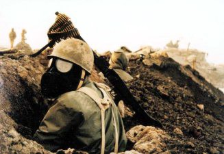 An Iranian soldier wearing a gas mask during the Iran-Iraq War