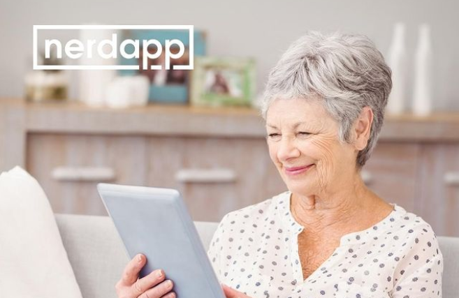 Elderly lady happy about her working iPad
