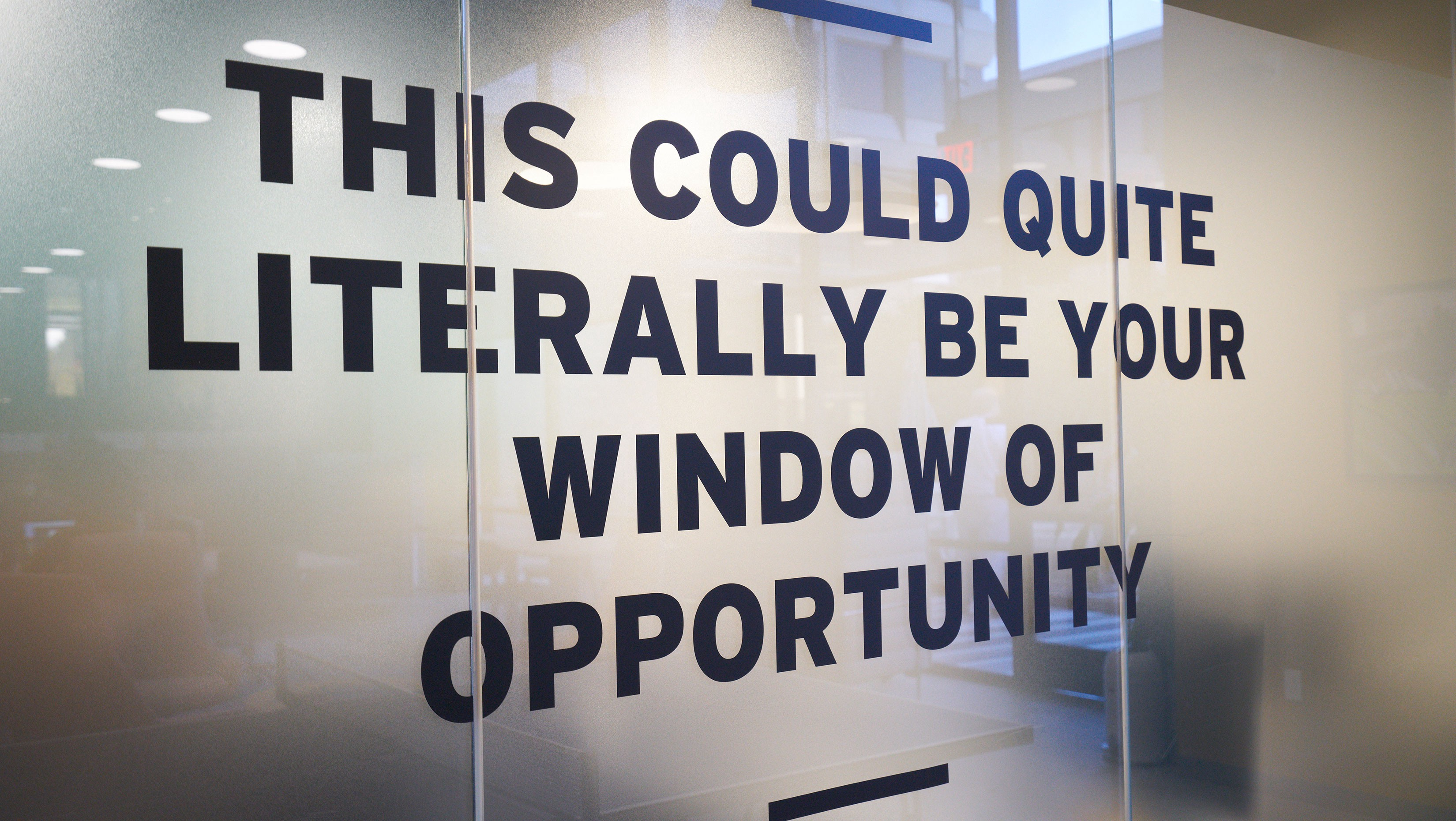 """Office glass wall saying """"This could quite literally be your windows of opportunity"""""""