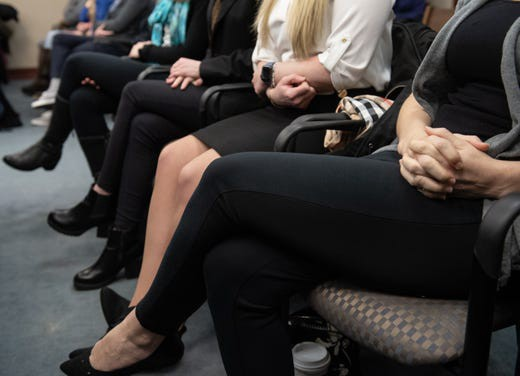 Nassar survivors clasp their hands during trial: Matthew Dae Smith/Lansing State Journal
