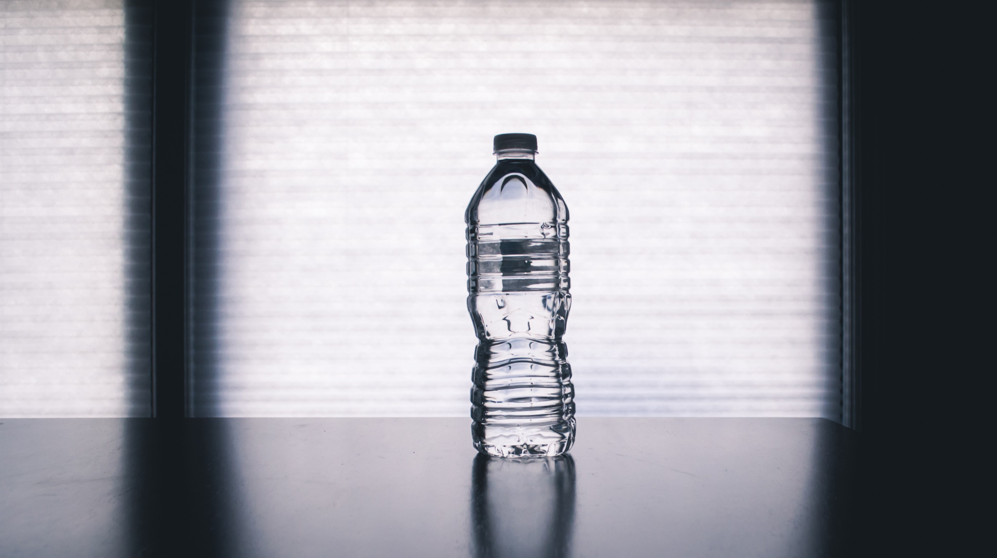 Bottled water placed on a surface.