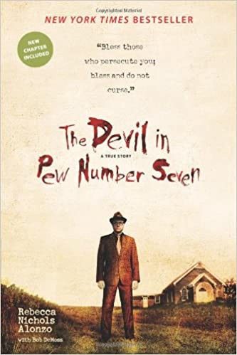 """Book cover: """"The Devil in Pew Number Seven"""" written in bloody letters, a male figure standing in front of a church and home imposingly."""