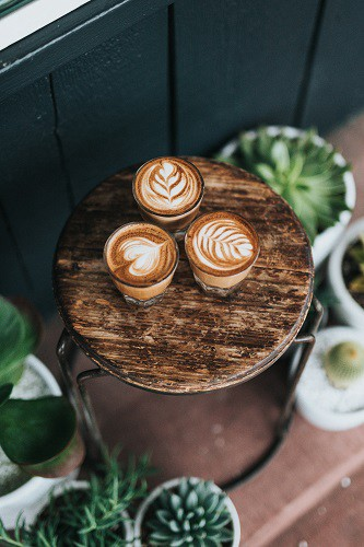 Three cups of coffee on a stool