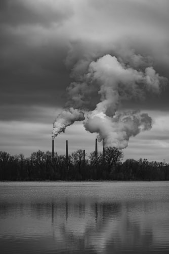 Industries polluting air with chimneys and water near them