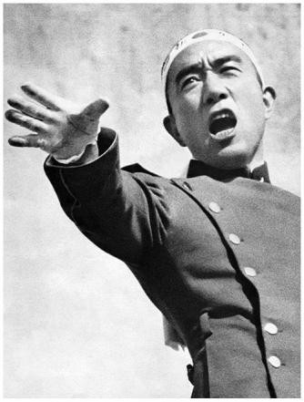 A live photograph of Mishima in his military attire yelling to the group during the hostage situation.