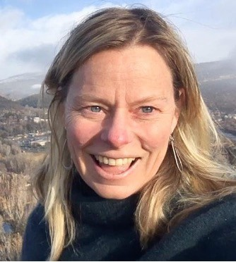 Dr. Heidi Steltzer in the mountains and hillslopes
