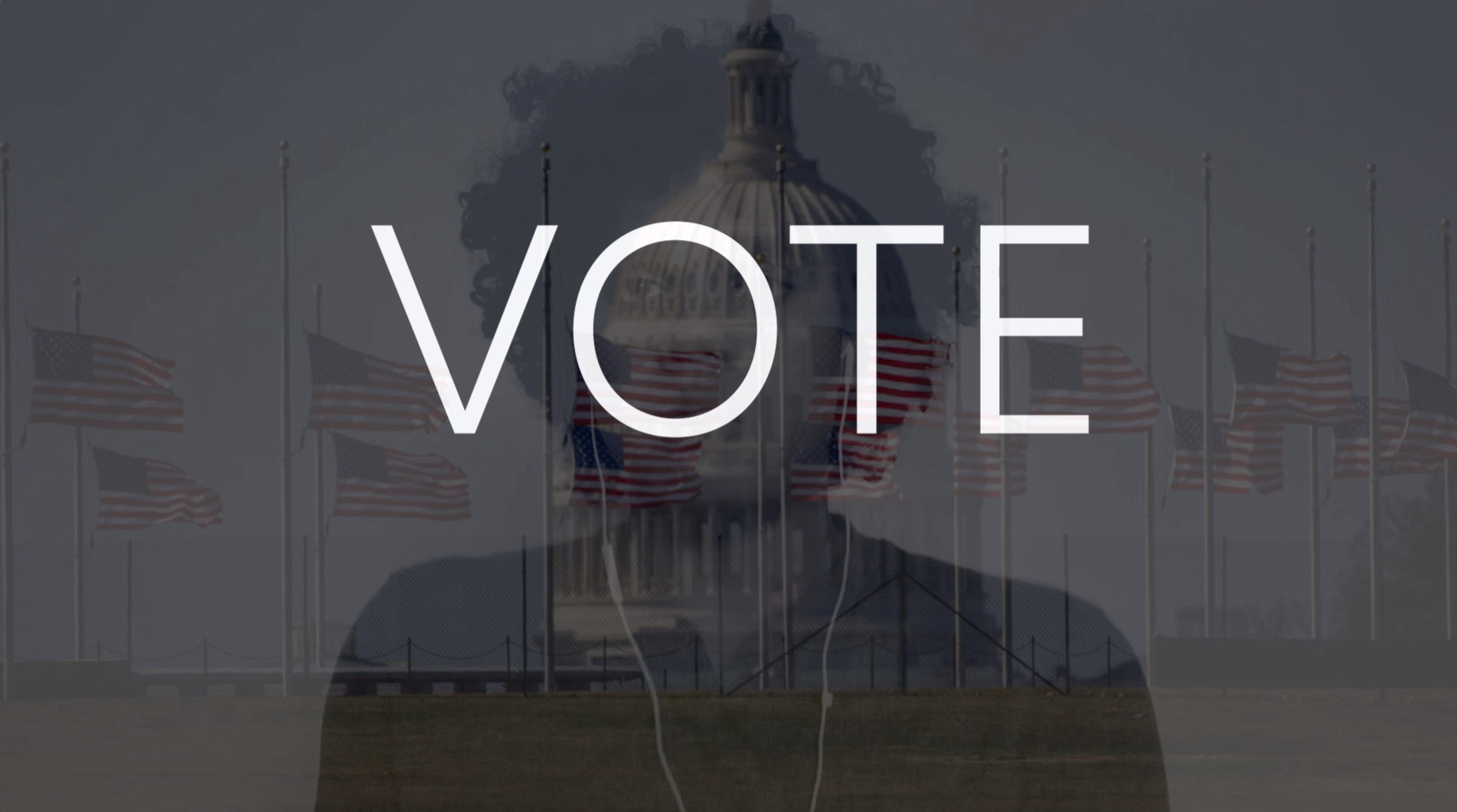 "Image from the music video showing the word ""Vote"""