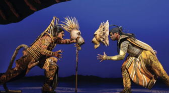 Scar and Simba in a final battle (Lion King on Broadway)