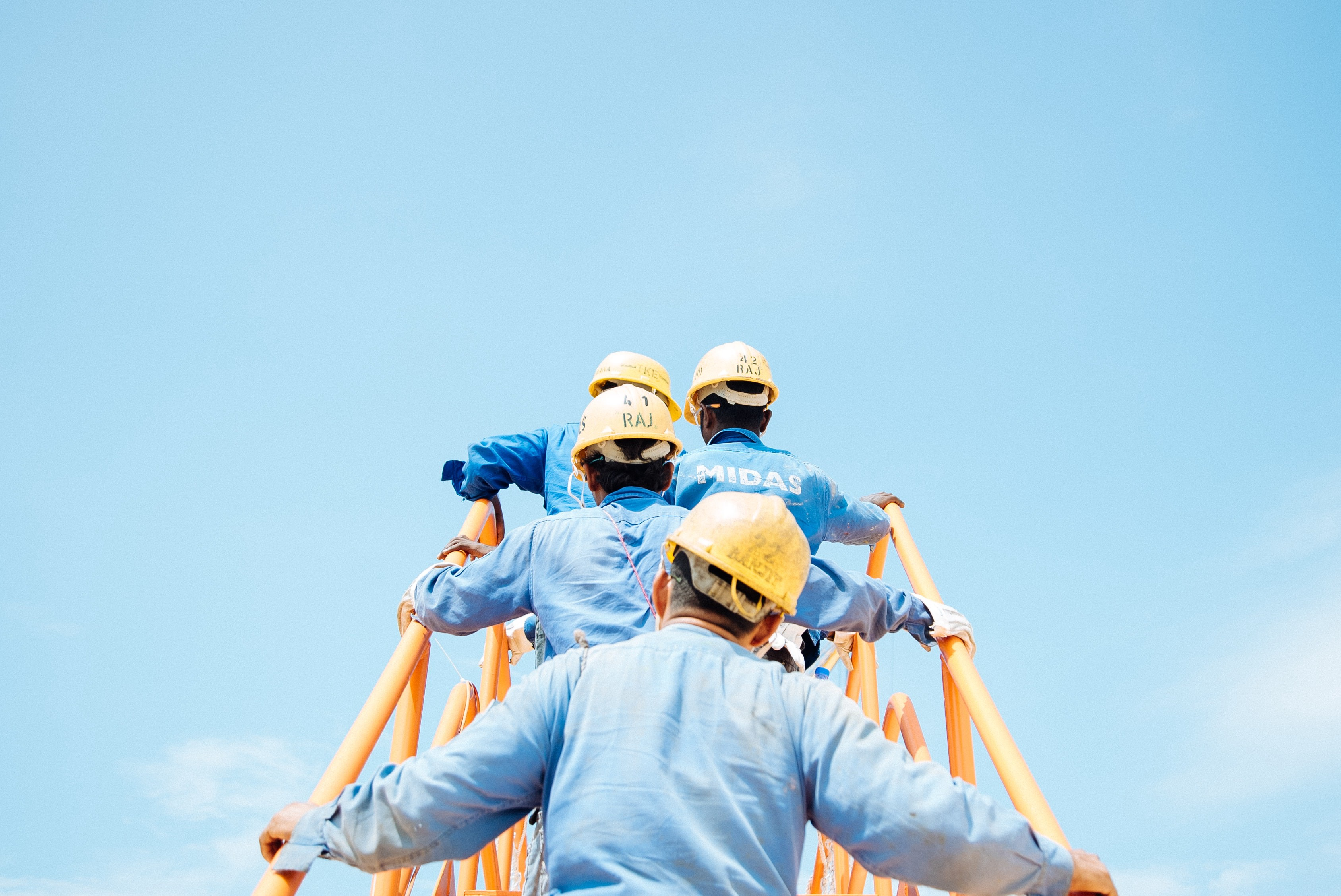 Construction workers with protective hats