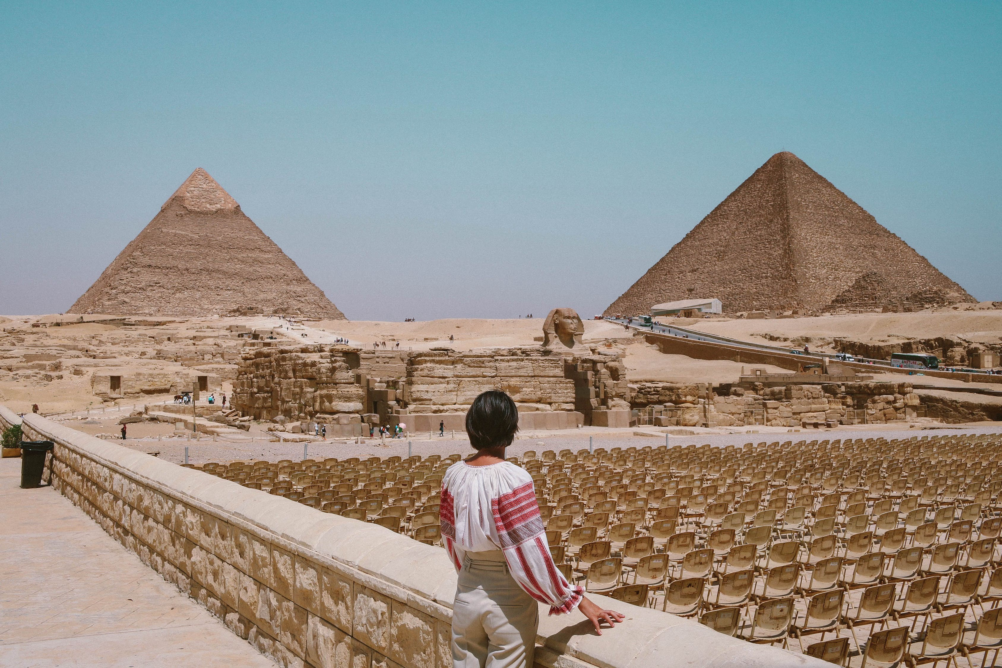 Traveler standing in front of pyramids in Egypt