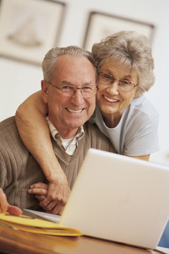 Smiling elderly couple looking into camera