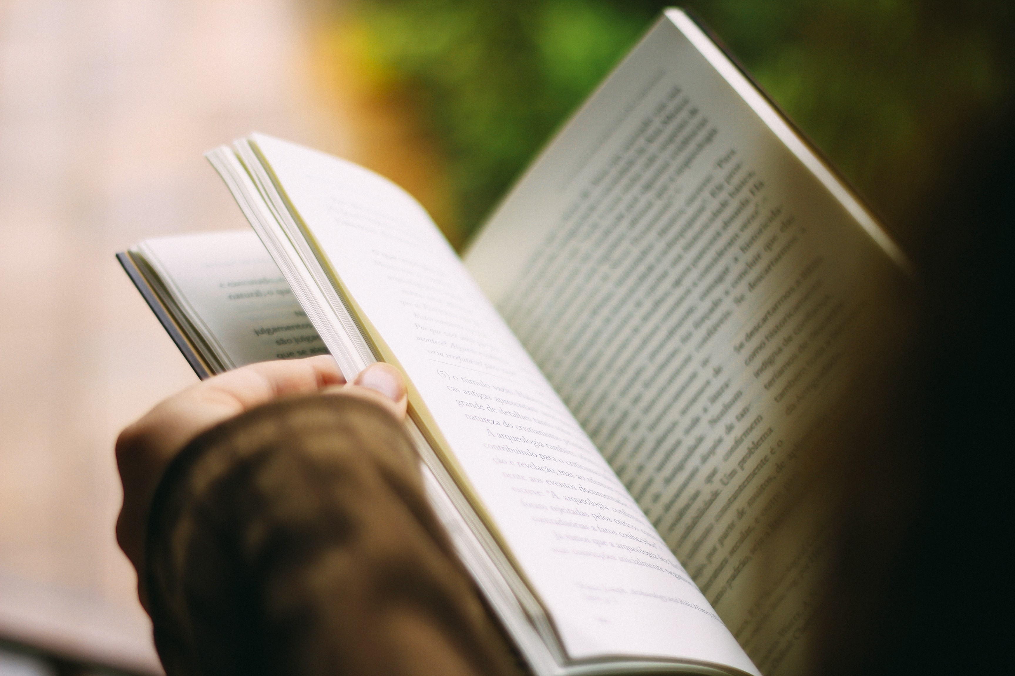 an open book with someone reading it