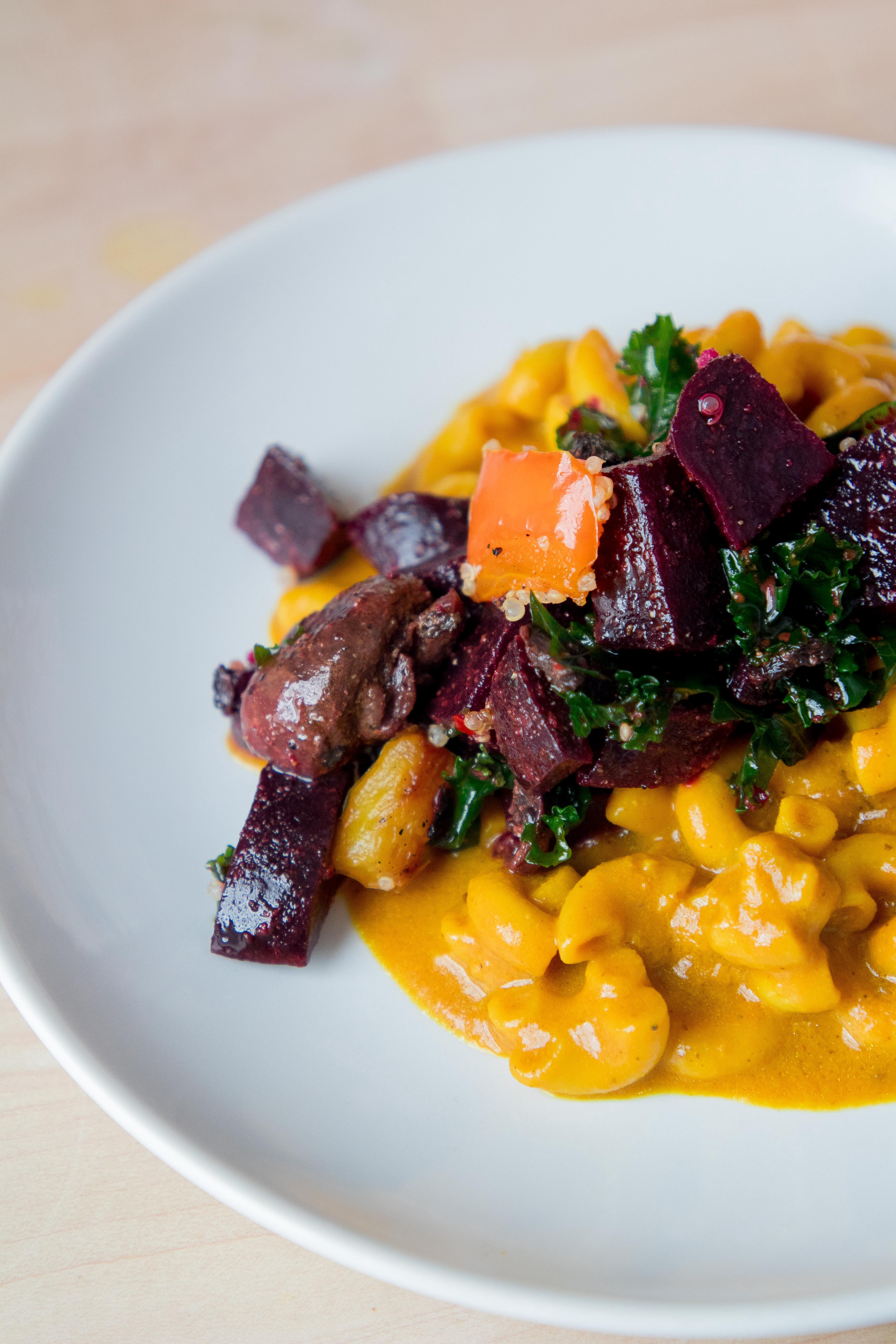 Vegan mac and cheese topped with beets