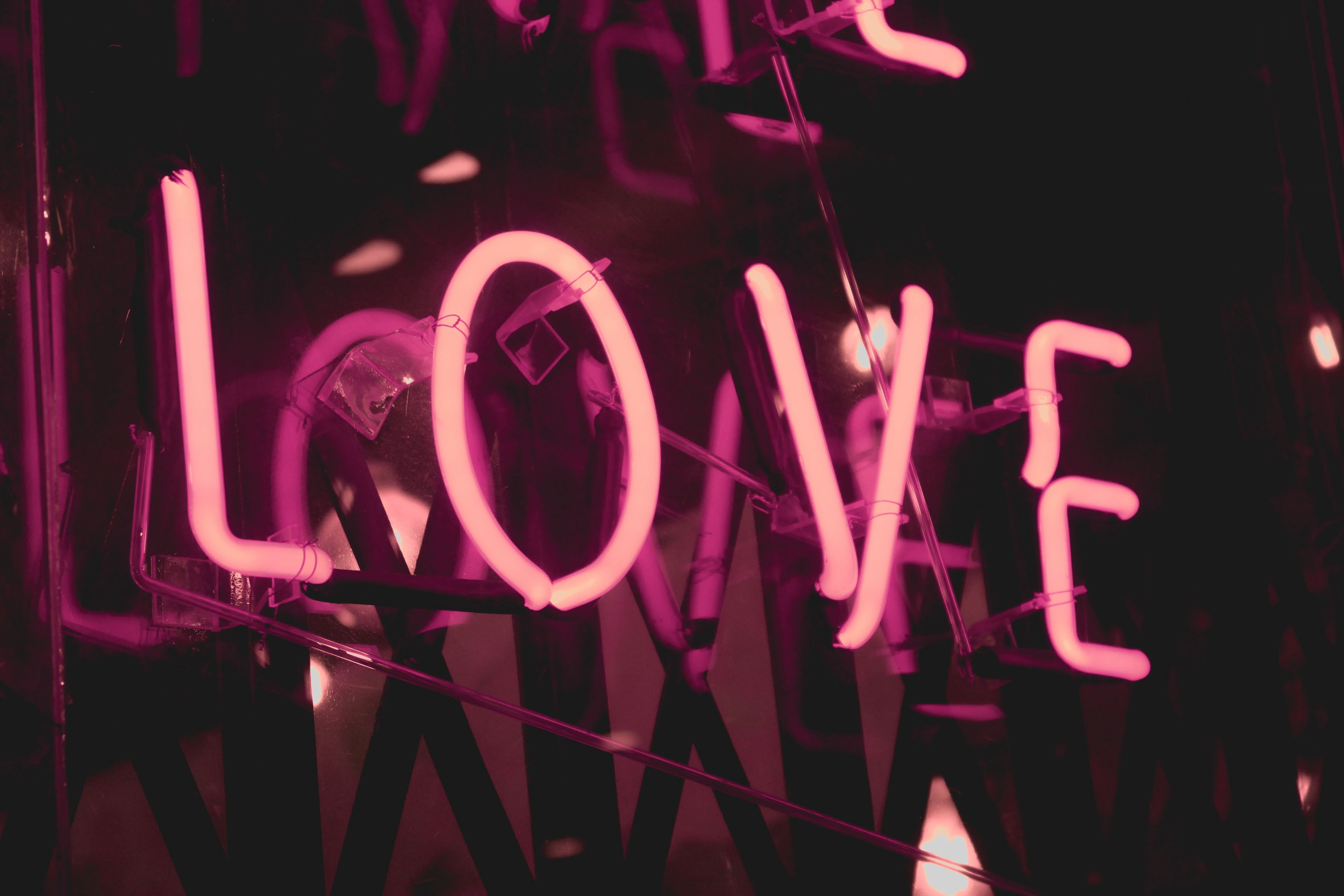 A neon sign of the world love