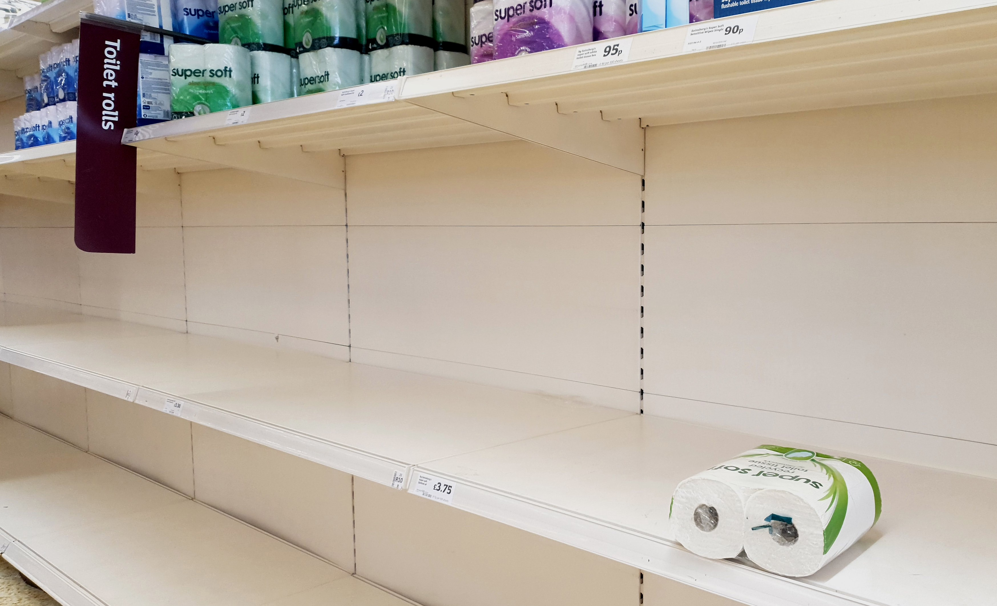 A view of empty shelves as toilet roll is almost sold out in a supermarket.