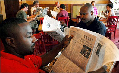 cafe patrons read the new orleans times-picayune a few months after hurricane katrina / new york times