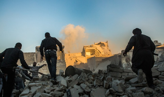 men run towards a blast site in aleppo / nicole tung for syria deeply
