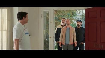 screen capture of progressive commercial with Lance Bass and co arriving at a residence.