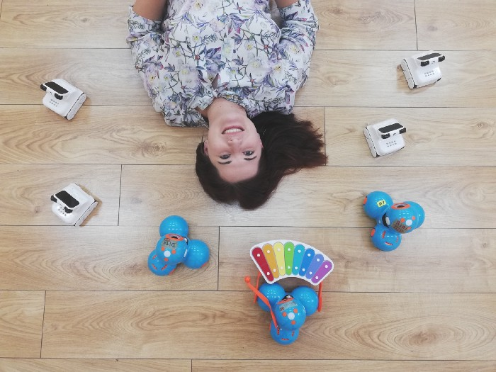 Women arounded by educational toys
